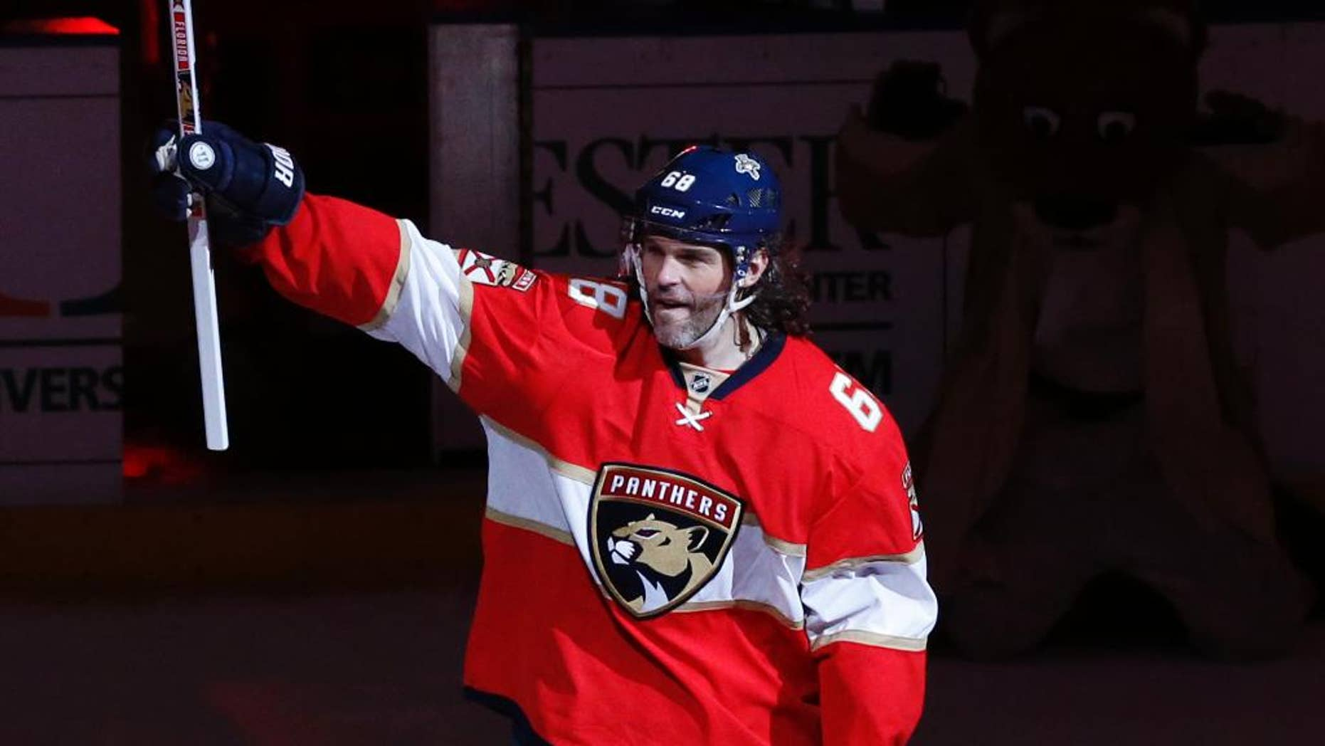 Florida Panthers right wing Jaromir Jagr (68) acknowledges the fans after the NFL hockey game against the Buffalo Sabres, Tuesday, Dec. 20, 2016, in Sunrise, Fla. Jagr tied Mark Messier for 2nd pace overall in NHL scoring with 1,887 points. The Panthers defeated the Sabres 4-3 in a shoot out. (AP Photo/Joel Auerbach)