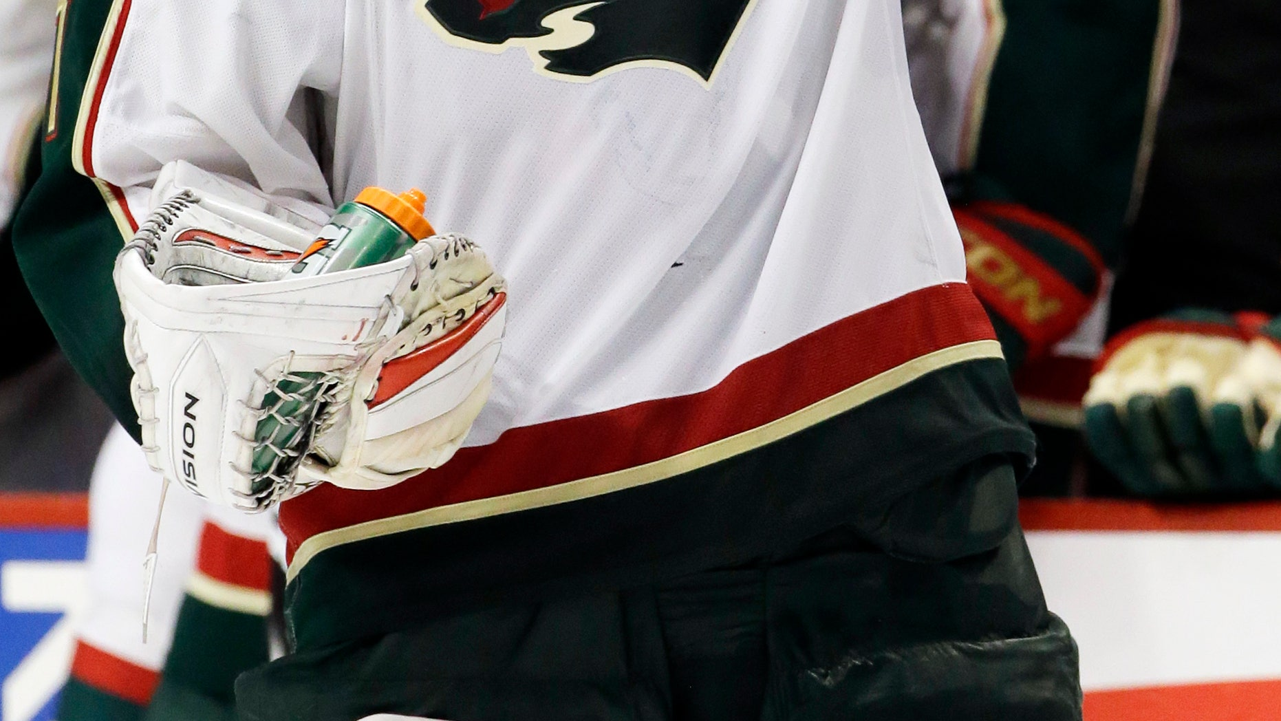 Minnesota Wild goalie Josh Harding puts on his helmet on during the second period of Game 2 of an NHL hockey Stanley Cup first-round playoff series against the Chicago Blackhawks in Chicago, Friday, May 3, 2013. (AP Photo/Nam Y. Huh)