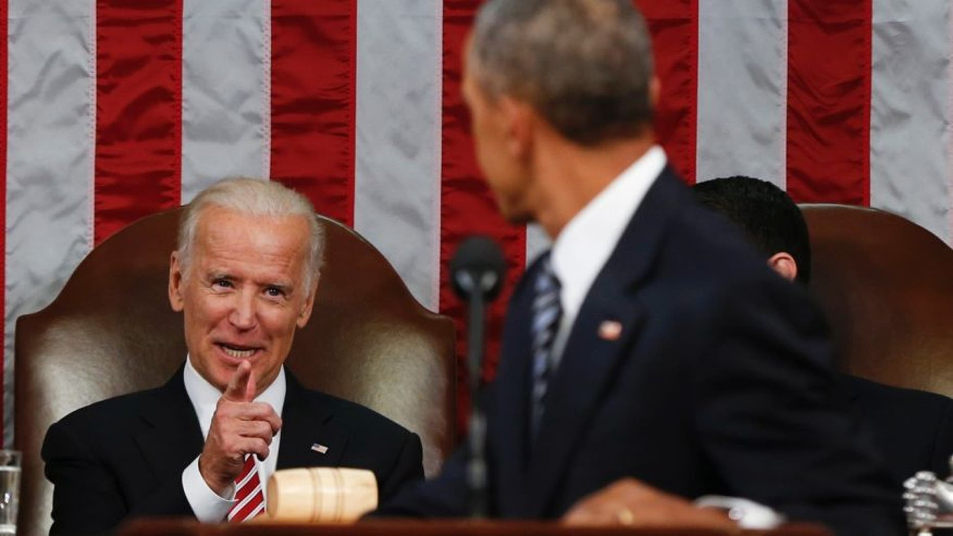 Jan. 12, 2016: Vice President Joe Biden points at President Barack Obama during the State of the Union address to a joint session of Congress on Capitol Hill in Washington.