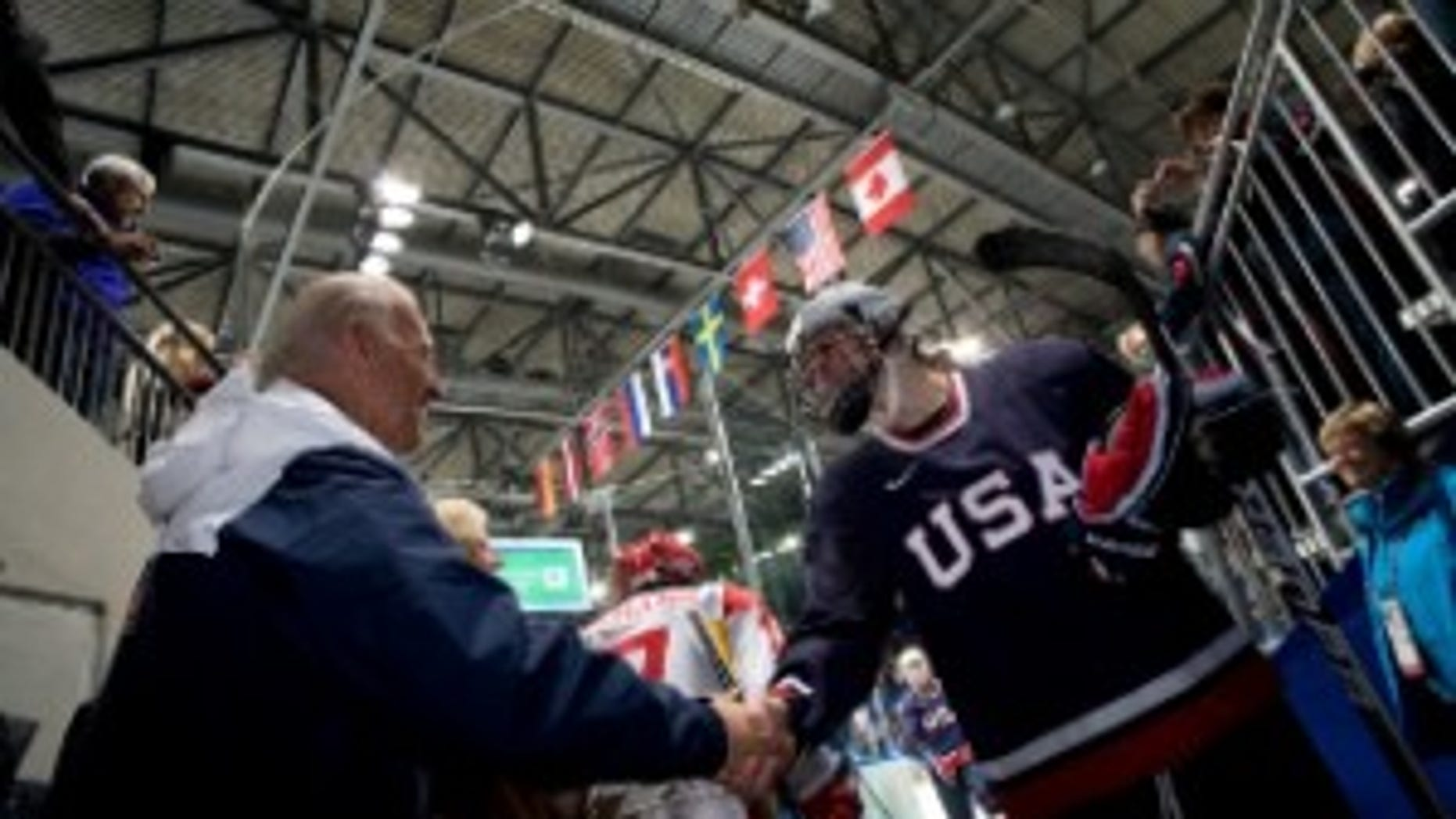 Vice President Joe Biden congratulates Team USA Women's Ice Hockey players after their win against the Peoples Republic of China at the 2010 Winter Olympics in Vancouver, Canada February 14, 2010. (Official White House Photo by David Lienemann)