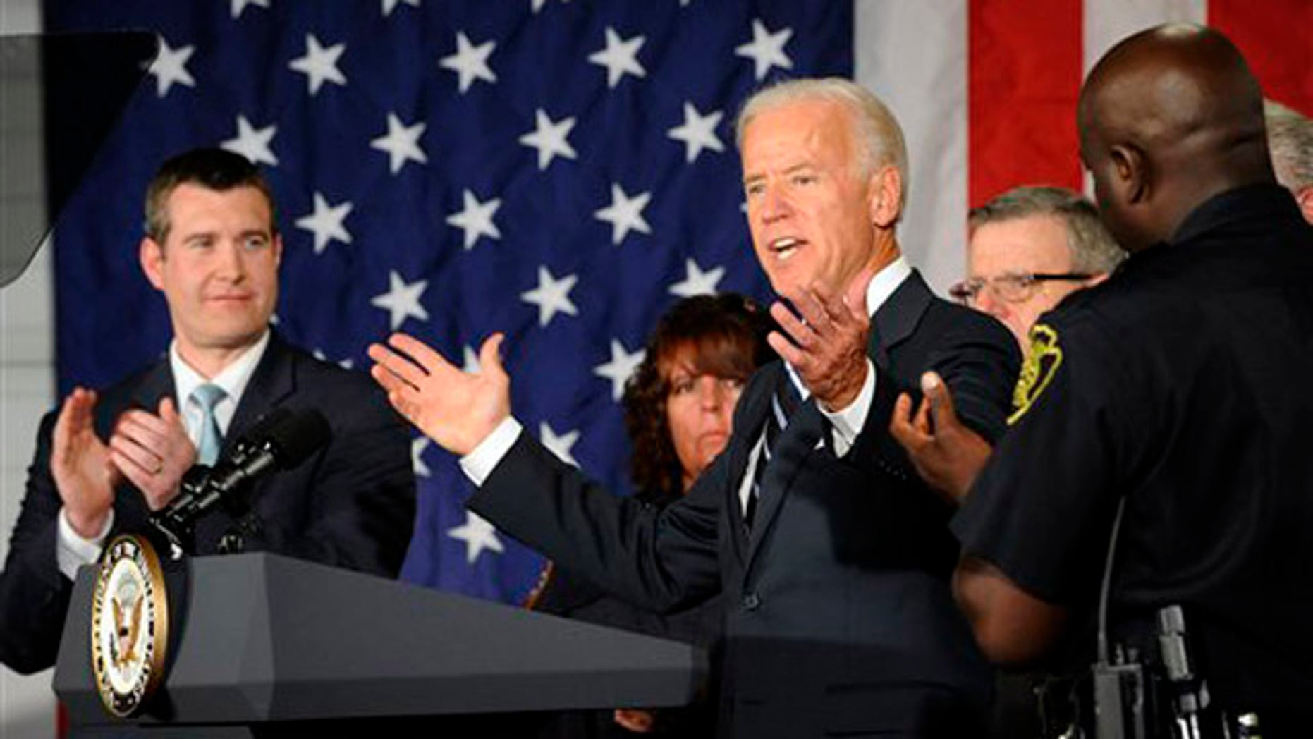 Vice President Biden speaks to public safety officers at a fire department building to promote the American Jobs Act in Flint, Mich., on Oct. 12.