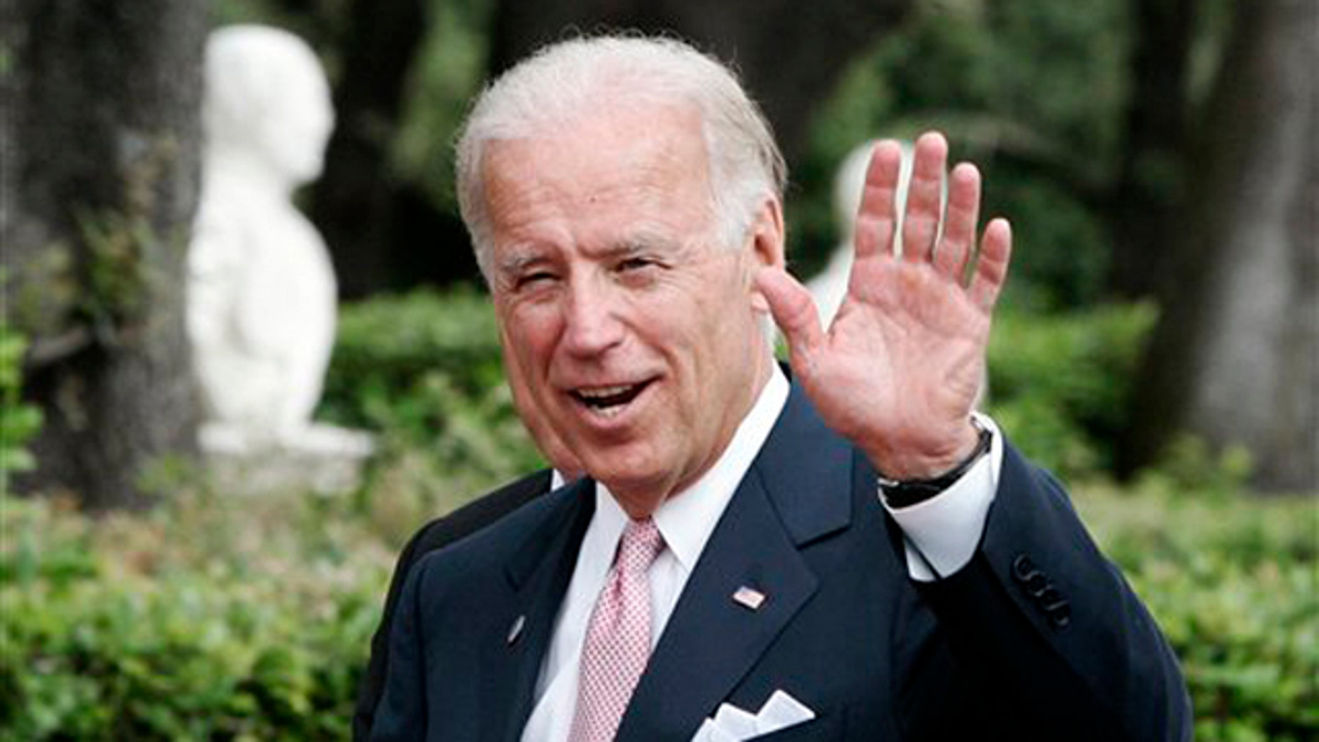 Vice President Joe Biden waves at Rome's Villa Doria Pamphili June 2.