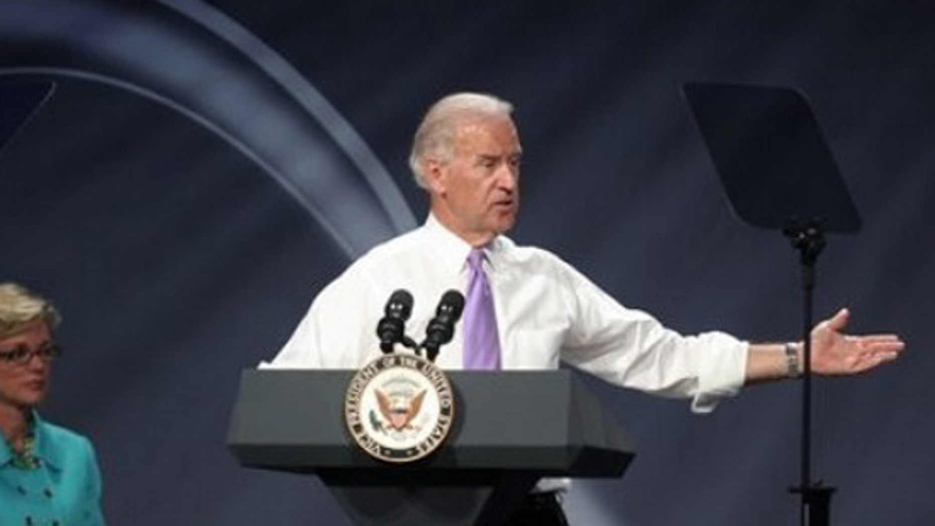 """Vice President Joe Biden addresses Dow Chemical, Dow Kokam employees, members of the public and the media during the Dow Kokam battery plant groundbreaking in Midland, Mich. Monday June 21, 2010. The plant will make lithium-ion battery packs for hybrid and electric vehicles, and will provide 700 to 800 """"green-collar jobs"""" and hundreds more for construction workers. Gov. Jennifer Granholm is seen at left. (AP Photo/ Bay City Times, Michael Randolph)"""