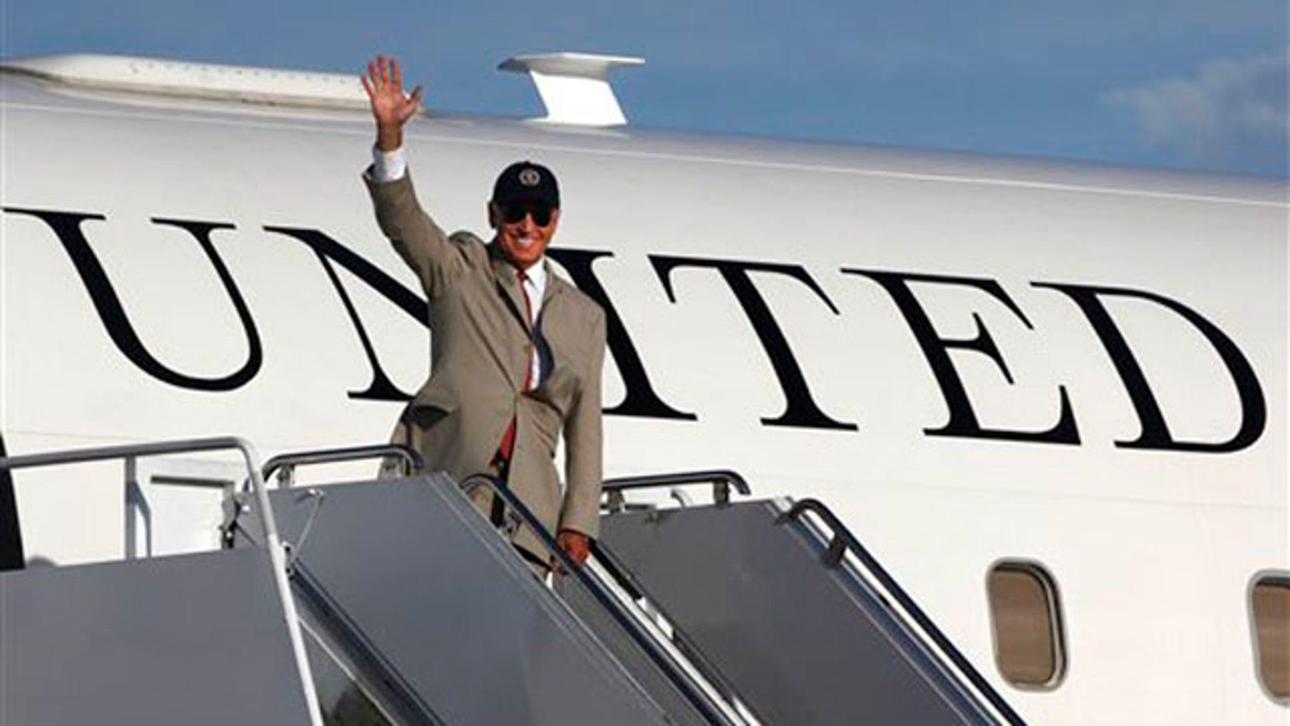 August 24: Vice President Joe Biden waves before boarding his plane at Yokota Air Base, on Tokyo's outskirts.