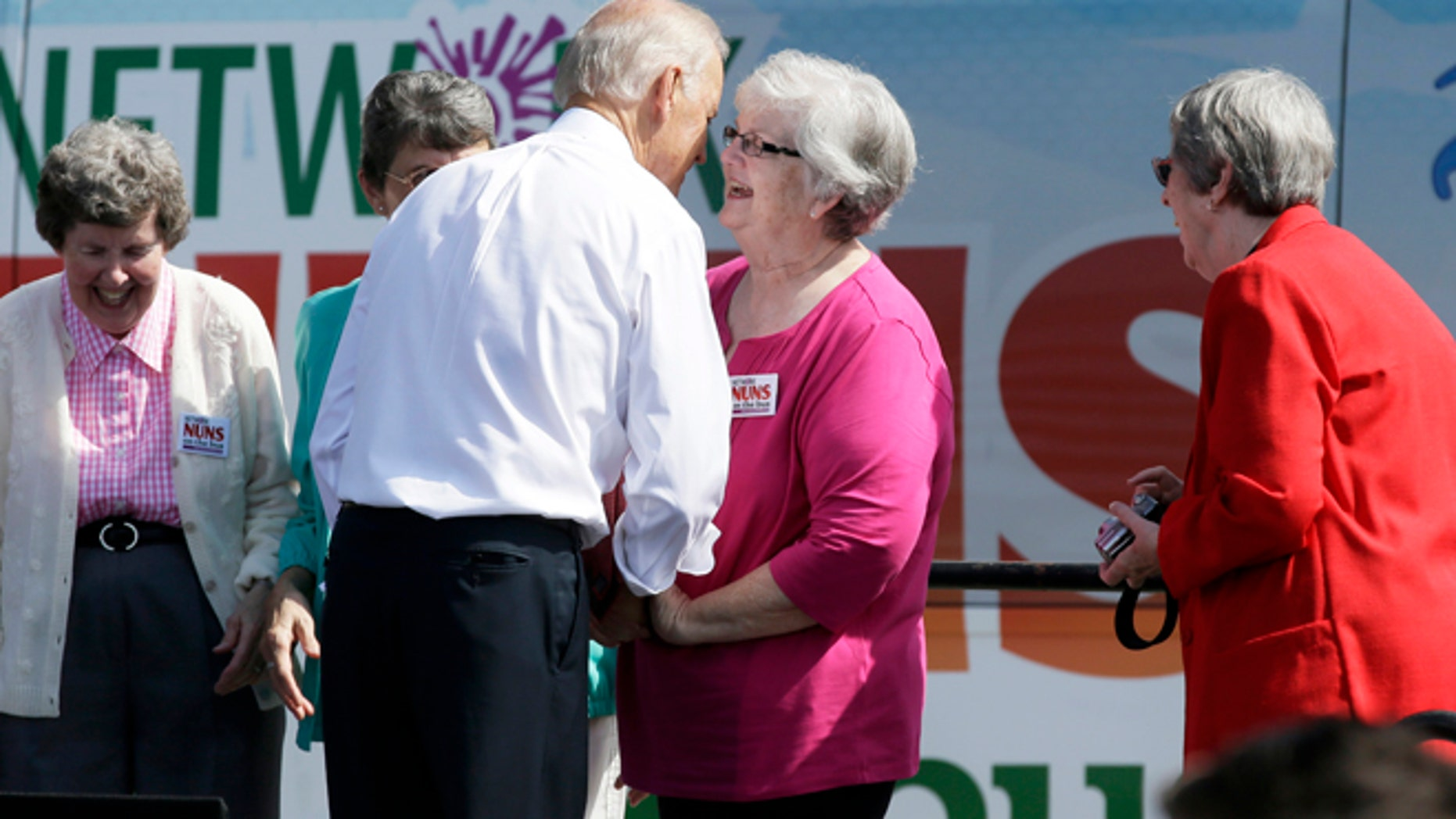 Sept. 17, 2014: Vice President Joe Biden speaks to a Catholic nun during the kickoff of the Nuns on the Bus at the Statehouse in Des Moines, Iowa. (AP)