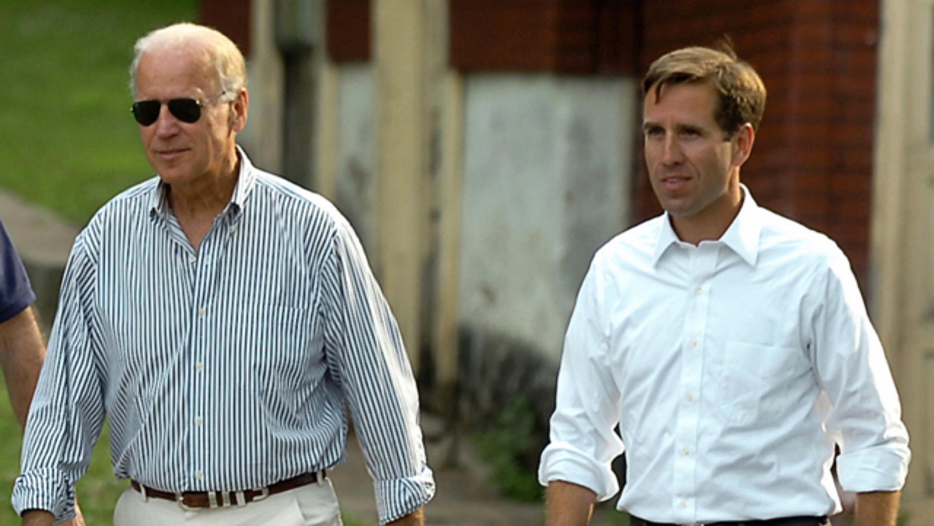 FILE: July 4, 2012: Delaware Attorney General Beau Biden, right, takes a walk with his father,Vice President Joe Biden, to the Green Ridge Little Baseball Field in Scranton, Pa.