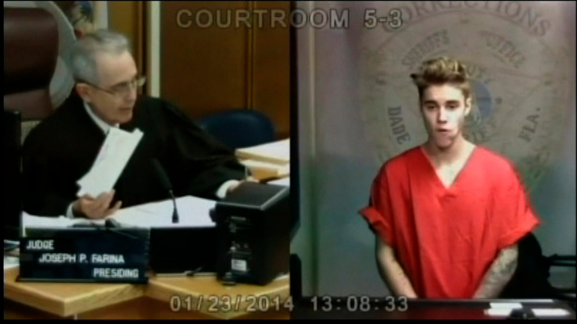January 23, 2014. Pop singer Justin Bieber appears in front of Judge Joseph Farina by video link in this still image from video from Miami, Florida.