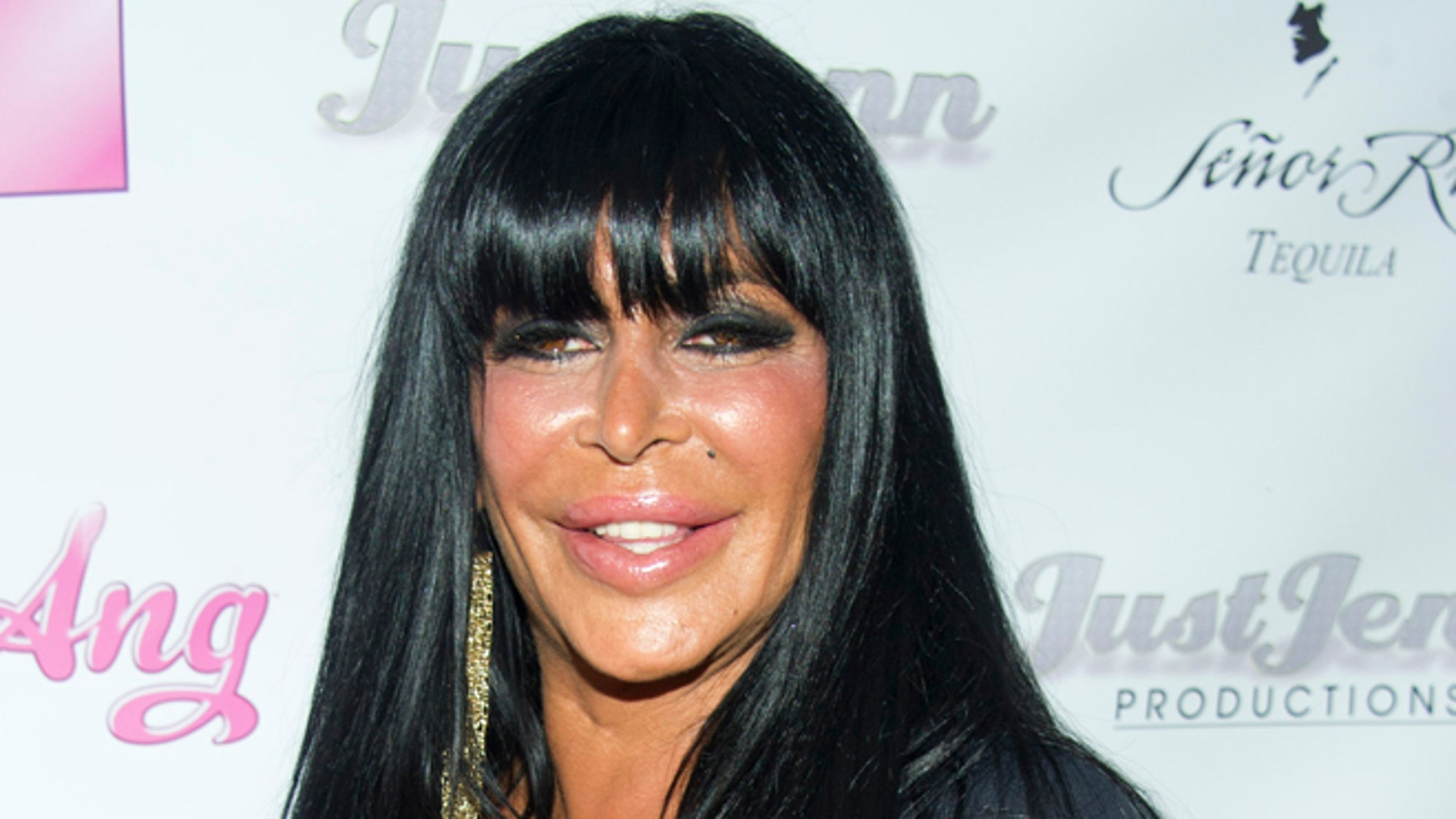 "July 8, 2012.  Angela Raiola, known as ""Big Ang,"" and her dog Little Louie arrive to the premiere of her VH1 reality show ""Big Ang"" in New York."