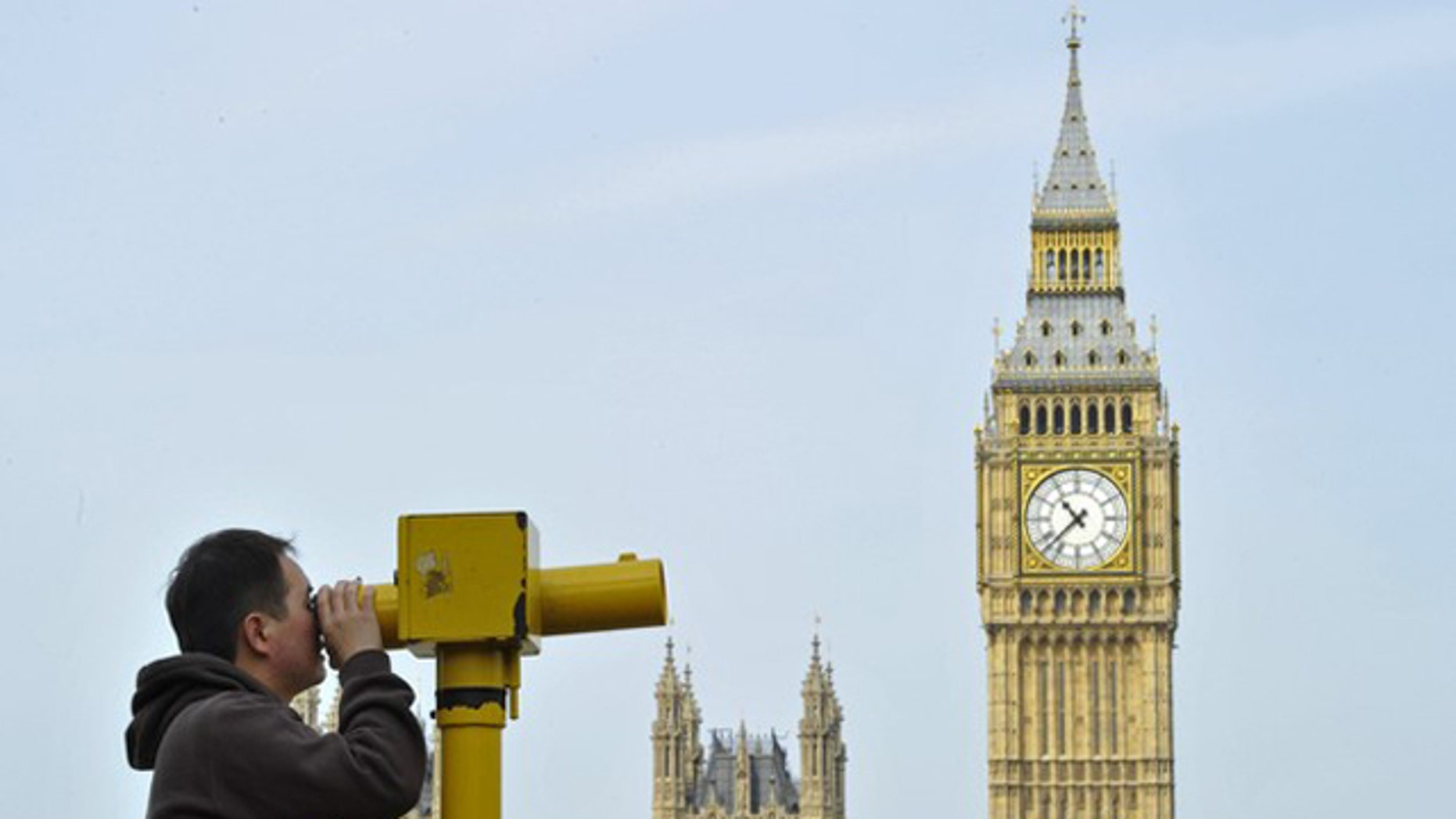 May 6: A man looks through a telescope opposite Big Ben and the Houses of Parliament, in central London.