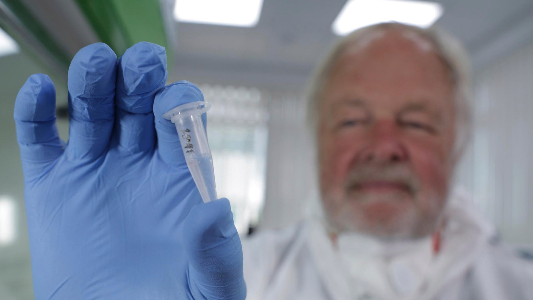 FILE: In this undated photo made available by Britain's Channel 4 television of Oxford University genetics professor Bryan Sykes posing with a prepared DNA sample taken from  hair  from a Himalayan animal.