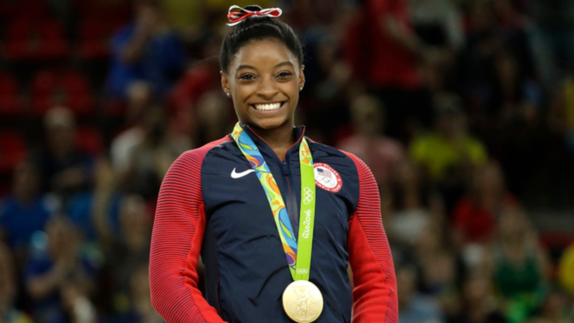 United States' Simone Biles smiles on the podium after winning vault gold during the artistic gymnastics women's apparatus final at the 2016 Summer Olympics in Rio de Janeiro, Brazil, Sunday, Aug. 14, 2016.