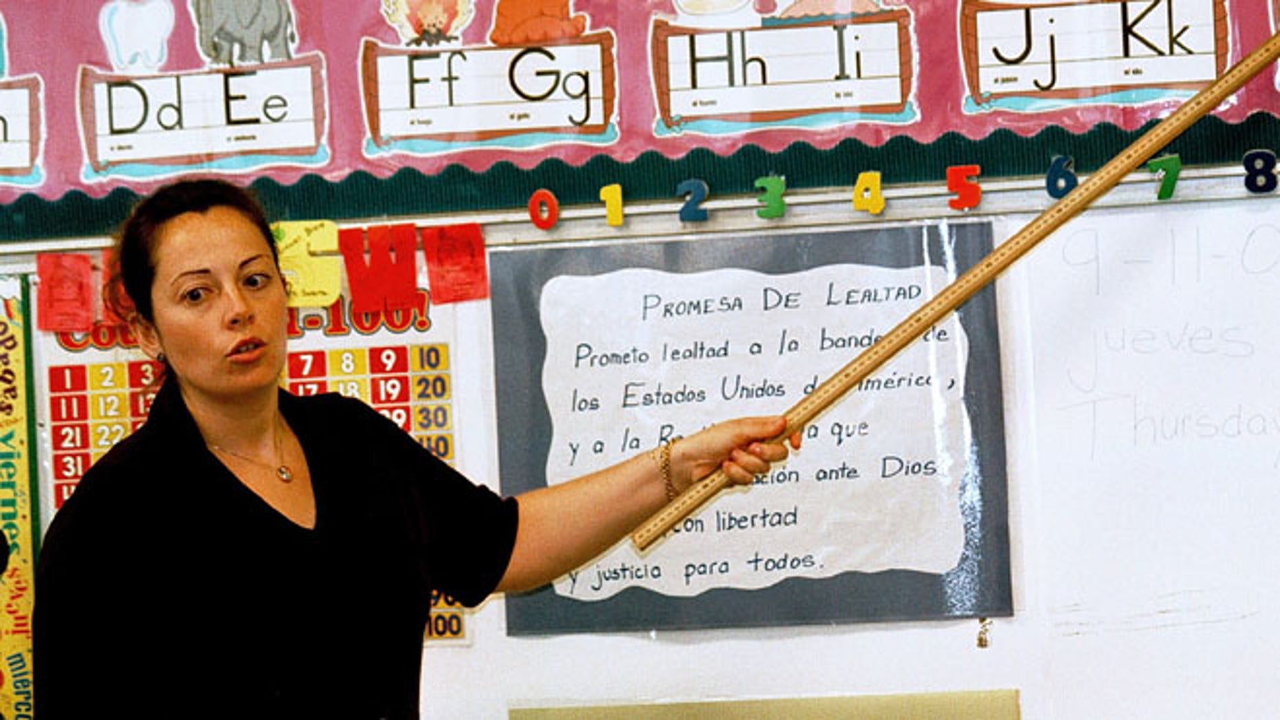 TYLER,TX - SEPTEMBER 11:  Lourdes Carmona, a Spanish speaking first grade teacher, instructs a class on the Spanish pronunciations of the alphabet at Birdwell Elementary School September 11, 2003 in Tyler, Texas. Carmona, a native of Spain, was recruited 5 years ago to teach Spanish speaking youngsters reading, writing, and arithmetic in their native language, as there was and continues to be a shortage of bilingual teachers in Texas. Carmona and her husband, also a native of Spain, are both employed by the Tyler Independent School District and permanently live in the east Texas city.  (Photo by Mario Villafuerte/Getty Images)