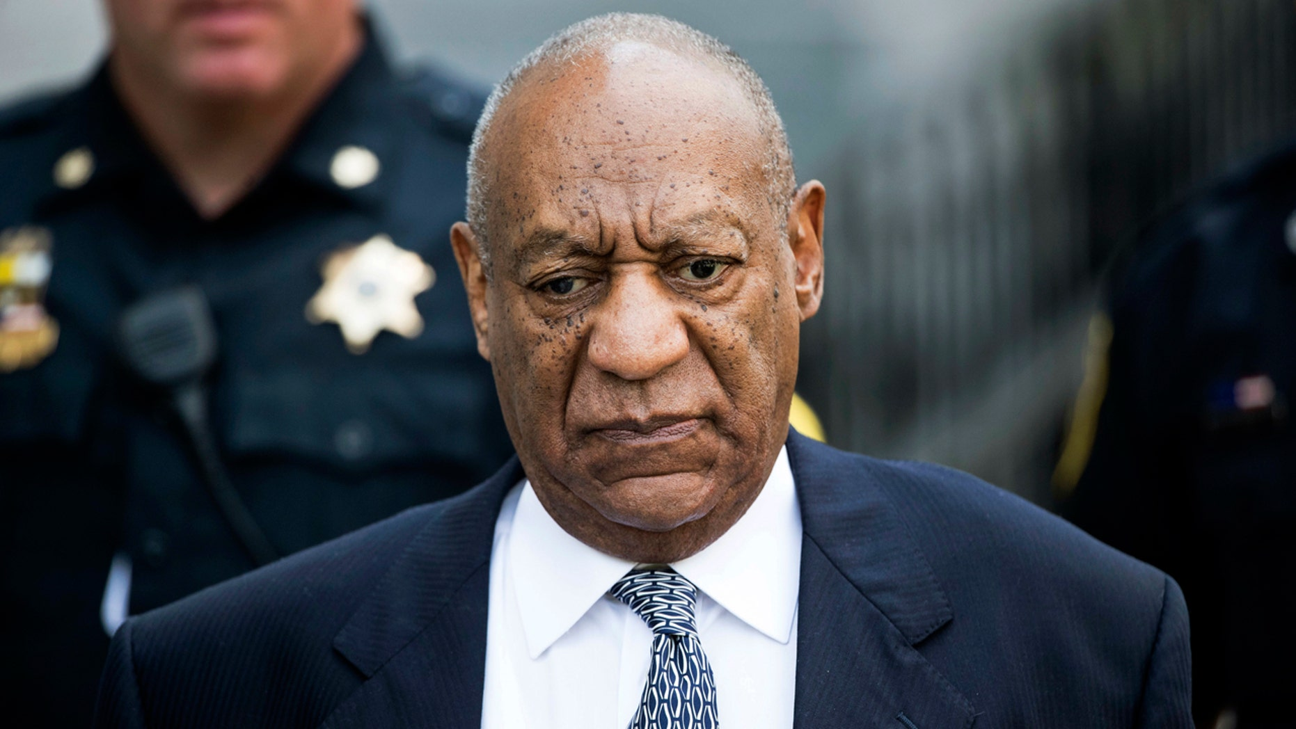 In this Aug. 22, 2017, file photo, Bill Cosby leaves Montgomery County Courthouse after a hearing in his sexual assault case in Norristown, Pa.