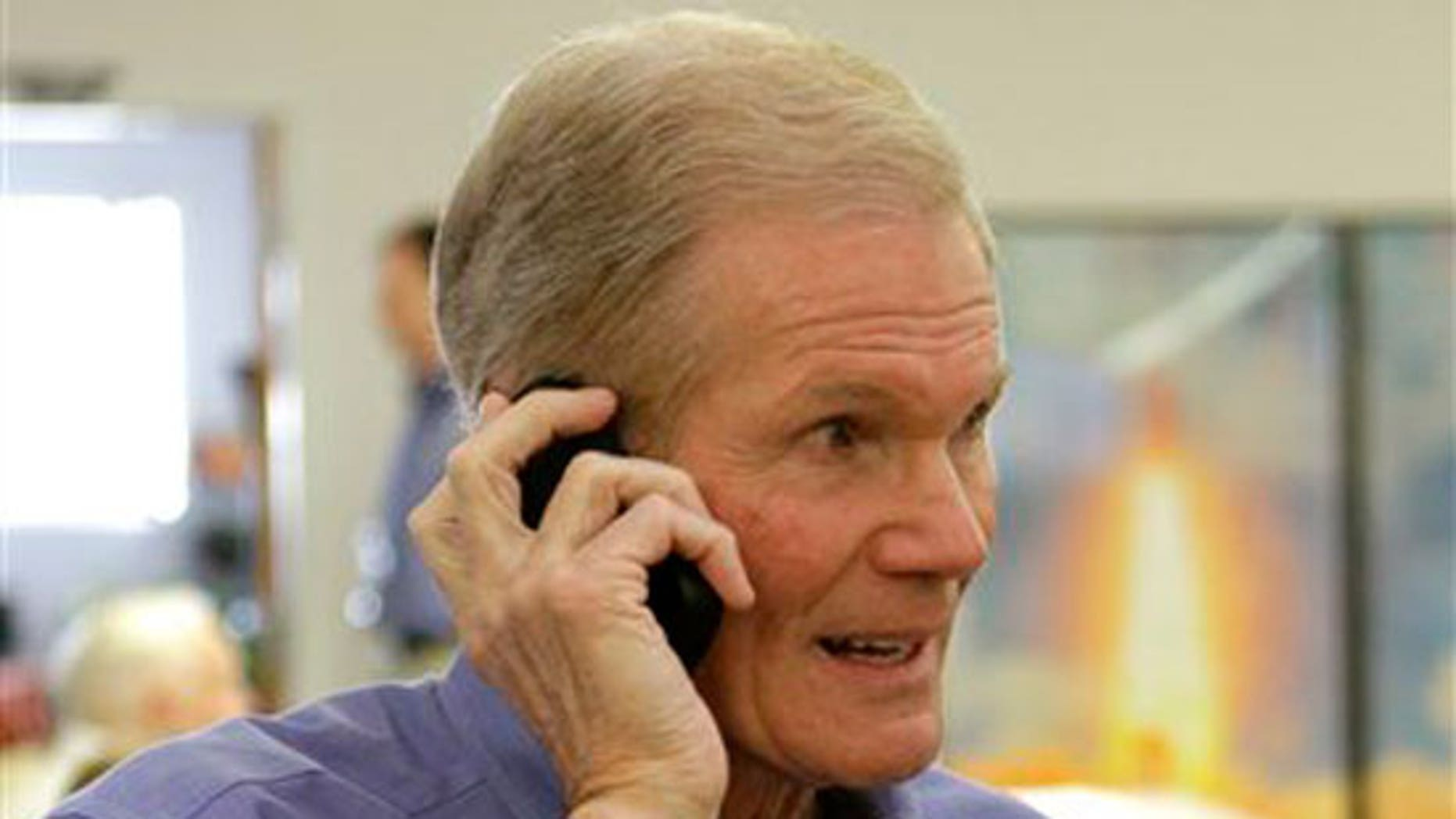 Sen. Bill Nelson, D-Fla., talks on his cell phone at the Kennedy Space Center press building prior to the launch of space shuttle Discovery in Cape Canaveral, Fla., Thursday, Feb. 24, 2011.(AP)