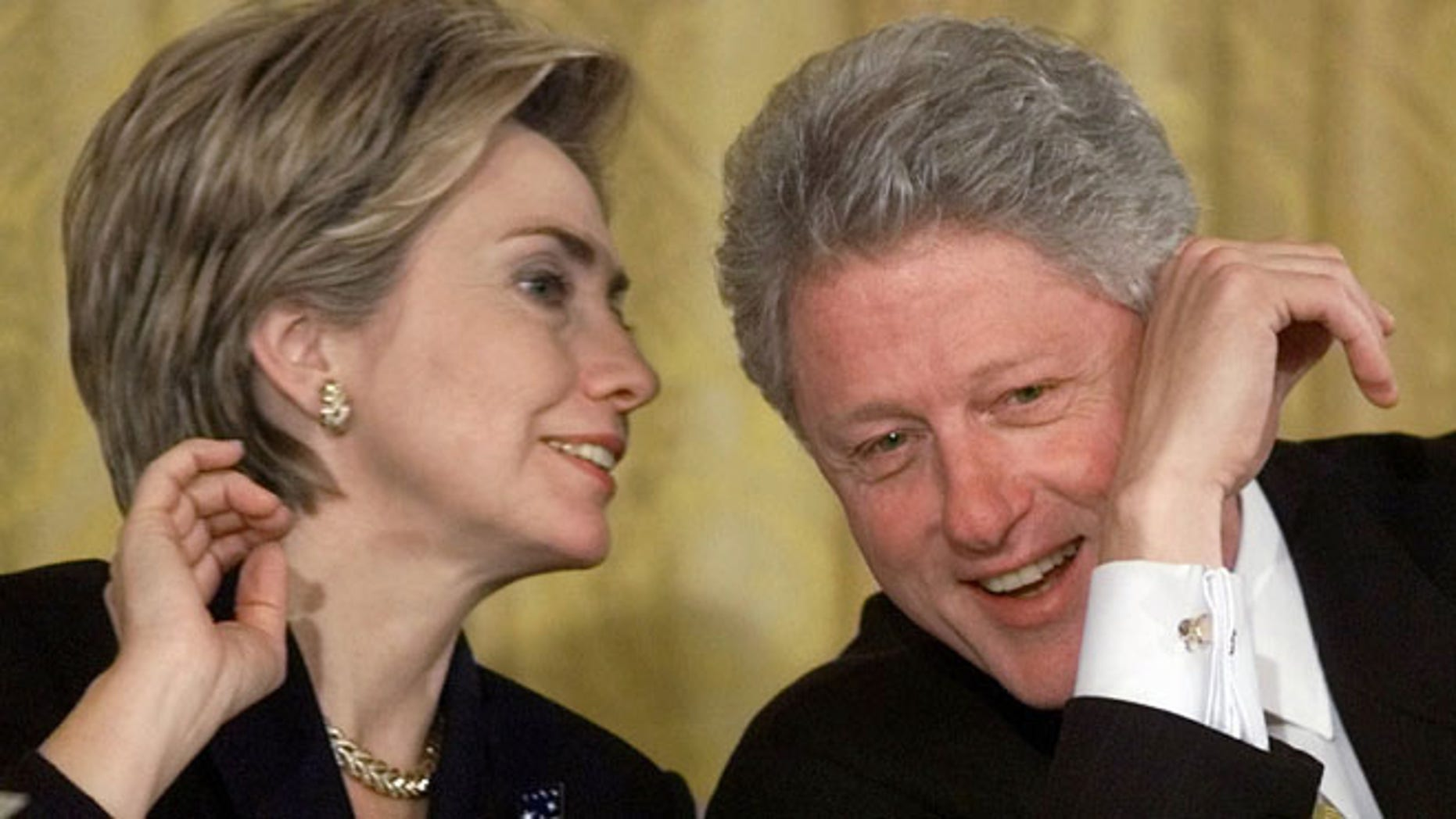 Oct. 22, 1999: President Bill Clinton and first lady Hillary Rodham Clinton talk during the White House Conference on Philanthropy in the East Room of the White House in Washington.