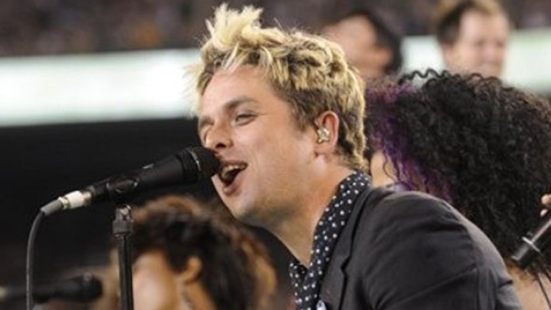 """FILE - In this Sept. 13, 2010 file photo, Billie Joe Armstrong of Green Day performs with cast members of the Broadway musical """"American Idiot"""" at halftime during an NFL football game between the New York Jets and the Baltimore Ravens at New Meadowlands Stadium in East Rutherford, N.J. Green Day front man Billie Joe Armstrong is joining the cast of """"American Idiot,"""" the Broadway show he helped create based on the band's 2004 Grammy-winning album, The Associated Press reported Sunday, Sept. 26, 2010. (AP Photo/Henny Ray Abrams, File)"""
