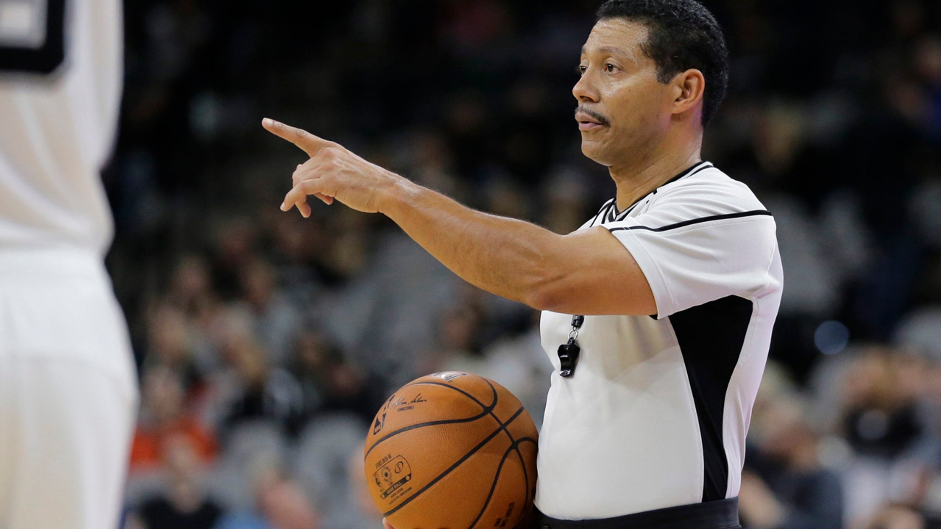 """NBA referee Bill Kennedy (55) during the second half of an NBA basketball game between the San Antonio Spurs and Utah Jazz, Monday, Dec. 14, 2015, in San Antonio. Kennedy has told Yahoo Sports he is gay after Sacramento Kings guard Rajon Rondo directed a gay slur at him during a game. Kennedy tells Yahoo he is """"proud to be an NBA referee and I am proud to be a gay man,"""" adding that he chose to come out in hopes of sending a message """"that you must allow no one to make you feel ashamed of who you are."""" (AP Photo/Eric Gay)"""