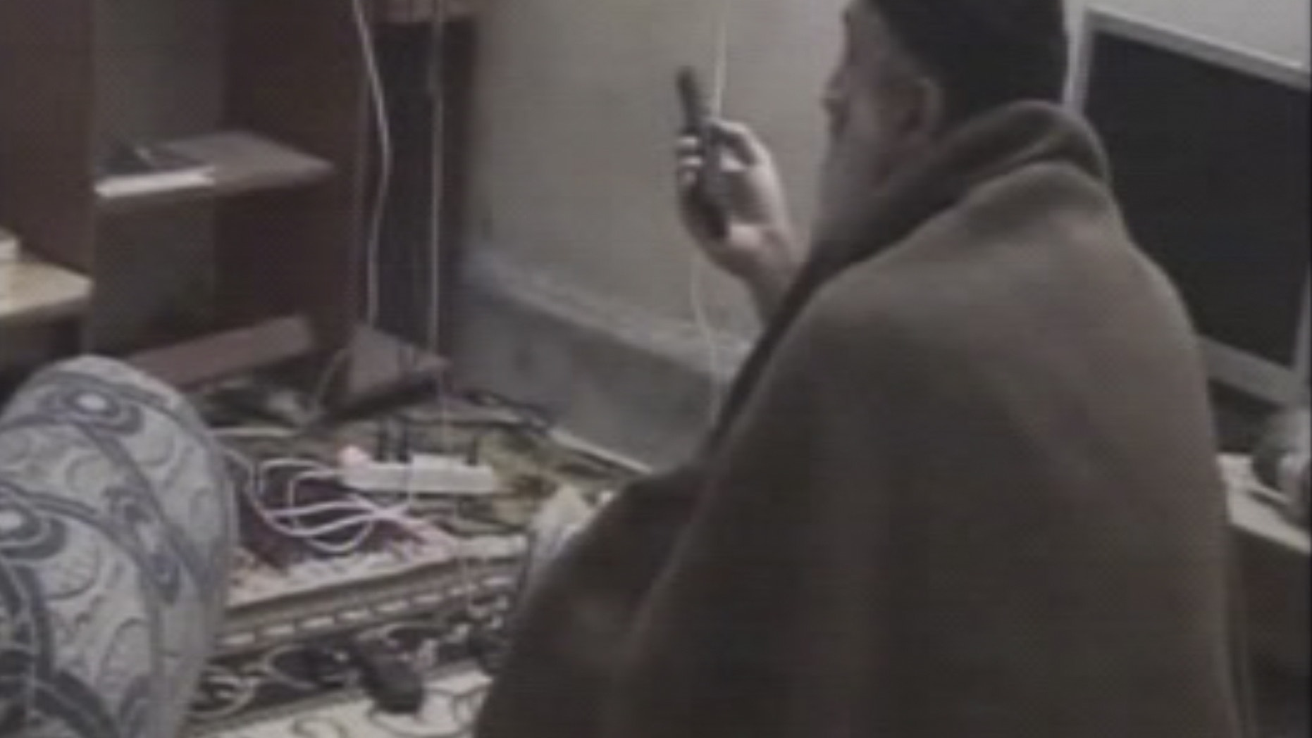 In this undated image taken from video provided by U.S. intelligence officials, a man who the American government says is Usama bin Laden watches television in a video released on Saturday, May 7, 2011.