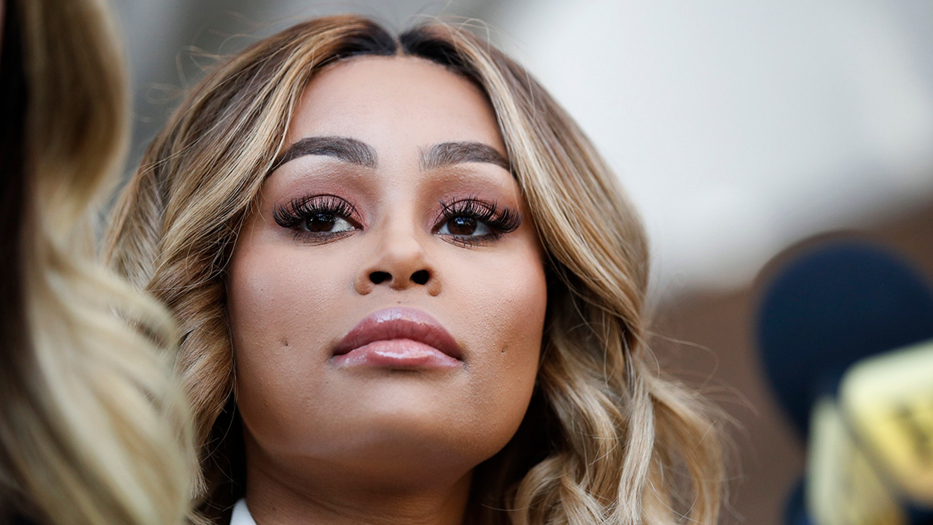 Rob Kardashian's ex-fiancee Blac Chyna listens to her attorney Lisa Bloom at a news conference after a hearing Monday, July 10, 2017, in Los Angeles. A court commissioner has granted Chyna a temporary restraining order against the reality television star. (AP Photo/Jae C. Hong)