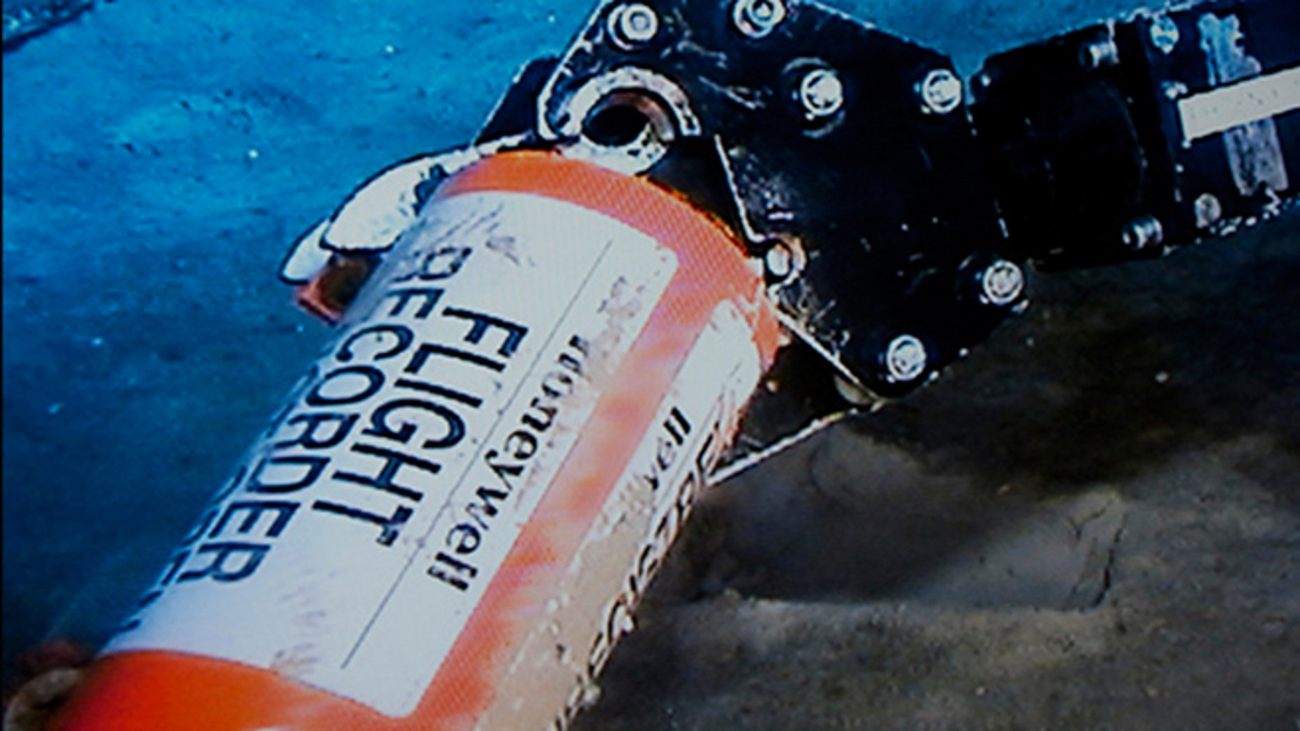 May 1, 2011: A mechanical arm, seen in this image published on the web site of France's BEA air accident inquiry offic, holds an orange cylindrical flight data recorder above the sand.