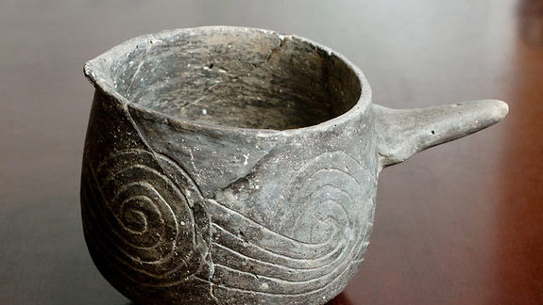 """Residents of Cahokia, a massive pre-Columbian settlement near the confluence of the Missouri and Mississippi Rivers, consumed """"black drink"""" from special pottery vessels like this one. The drink made them vomit and was likely consumed during purification rituals."""