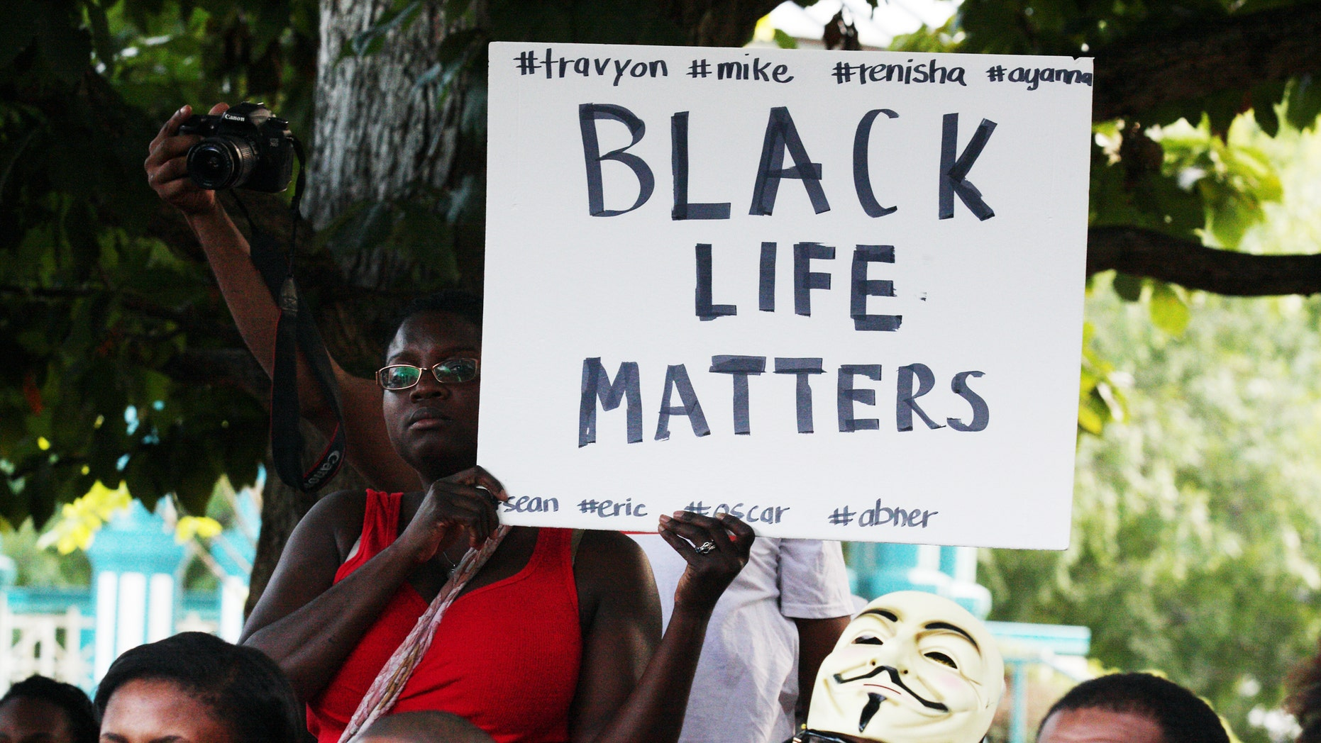 A demonstration on Thursday, Aug. 14, 2014, in Decatur, Georgia,