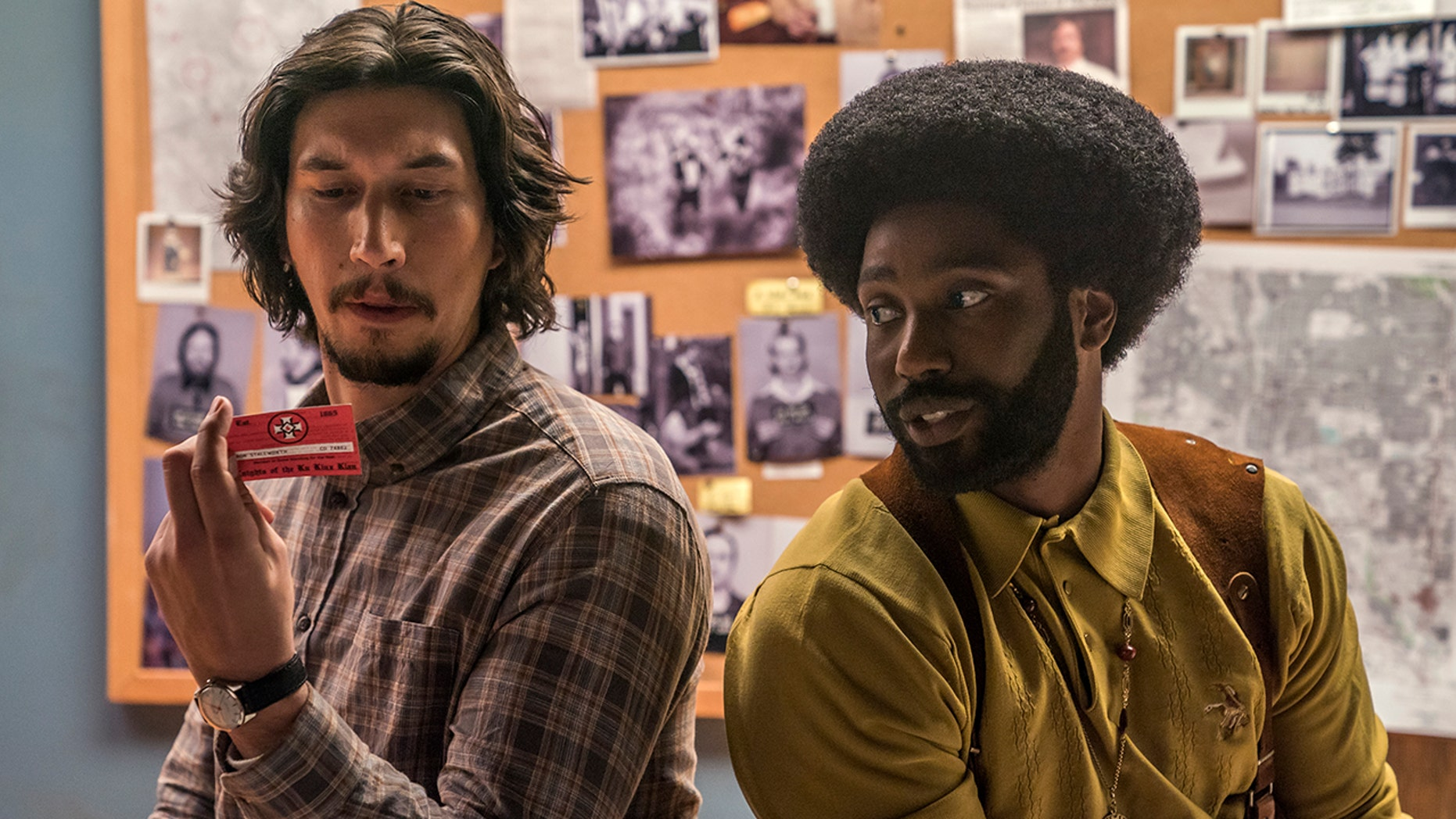 """This image released by Focus Features shows Adam Driver, left, and John David Washington in a scene from """"BlacKkKlansman."""""""