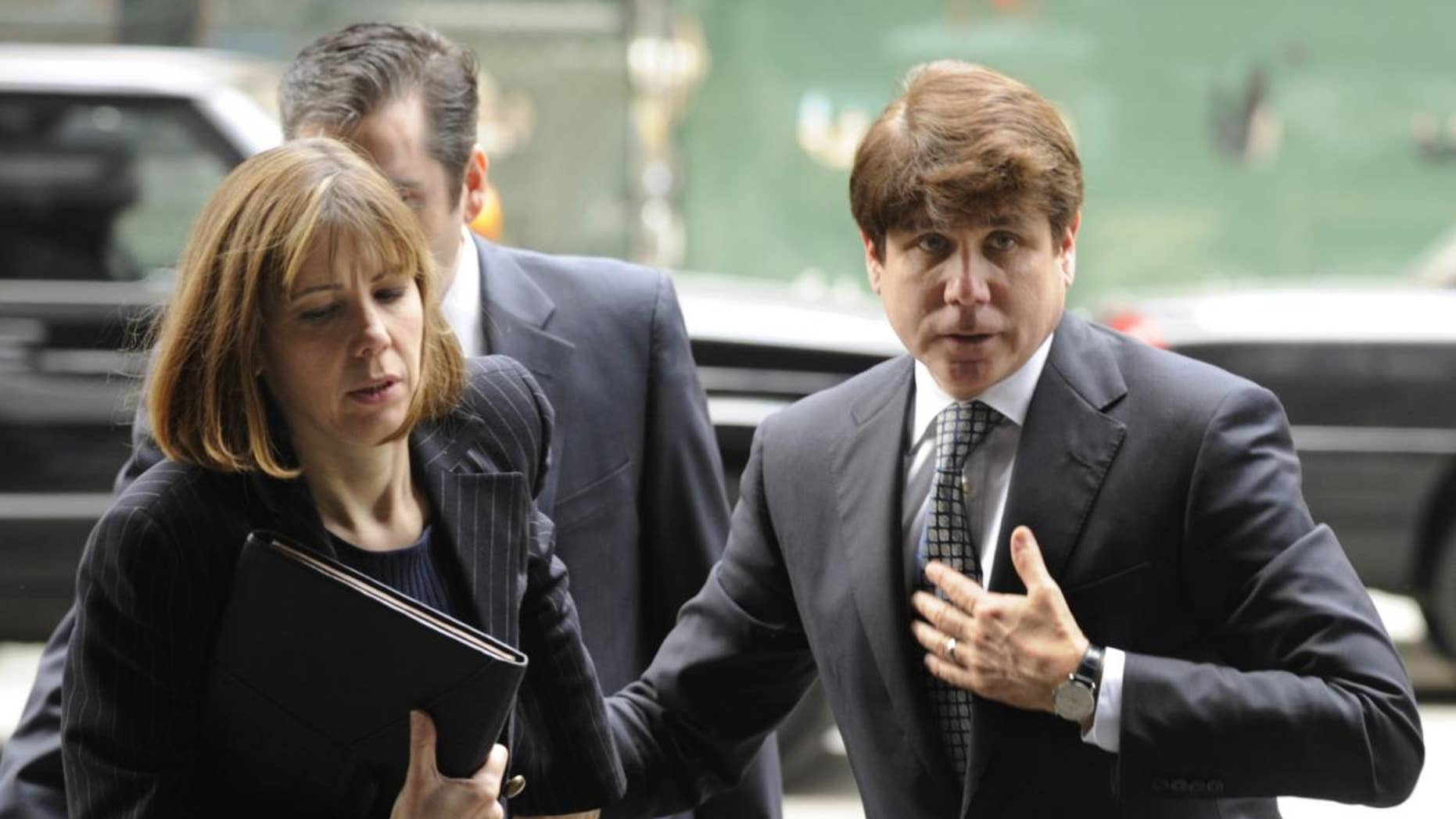 Former Illinois Gov. Rod Blagojevich and his wife Patti Blagojevich arrive at federal court for final jury selection and opening arguments in his second corruption trial, Monday, May 2, 2011, in Chicago. (AP Photo/Paul Beaty)