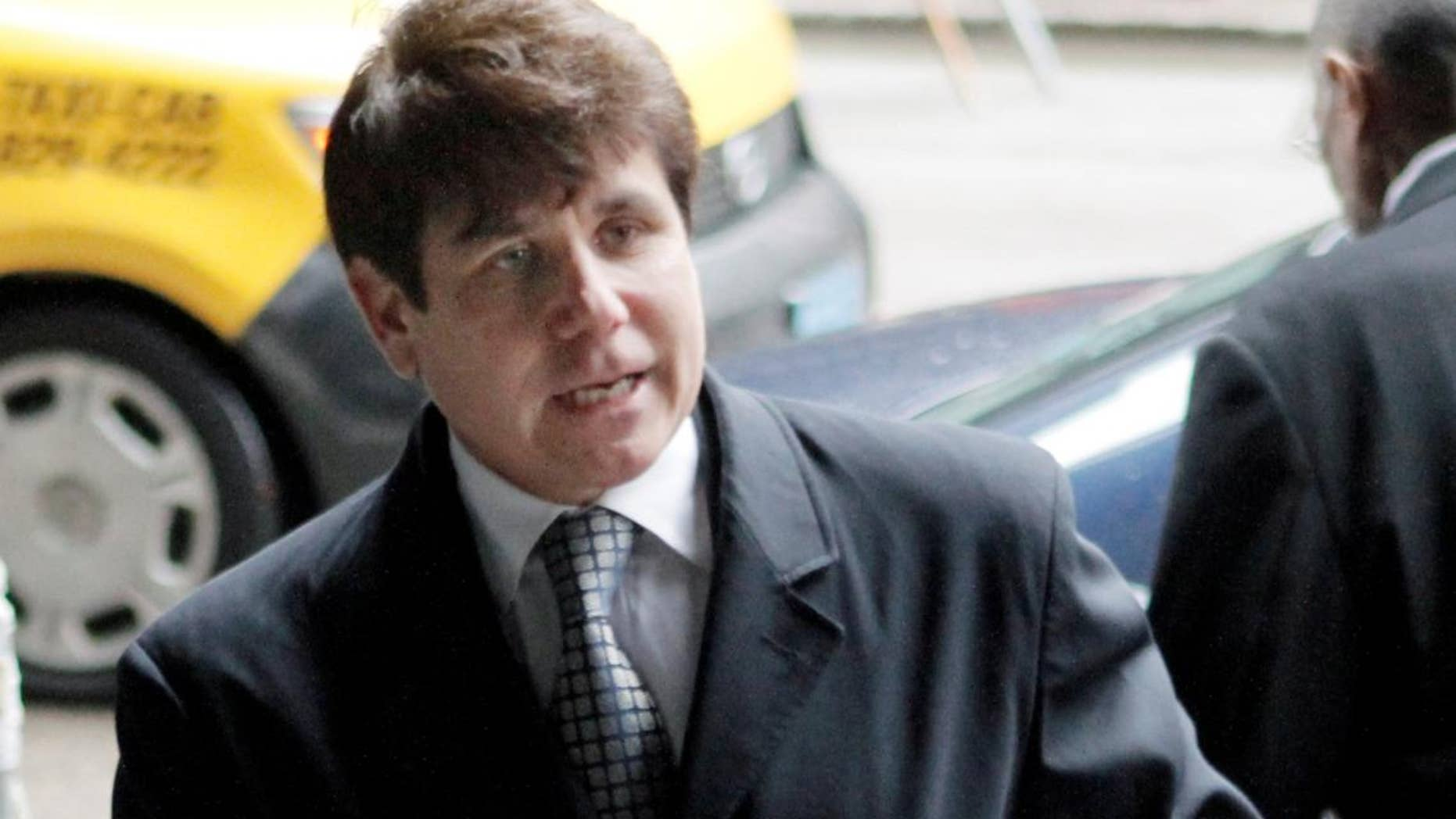 Former Illinois Gov. Rod Blagojevich, arrives at federal court before taking the stand in his second corruption trial, Thursday, May 26, 2011, in Chicago. (AP Photo/M. Spencer Green)