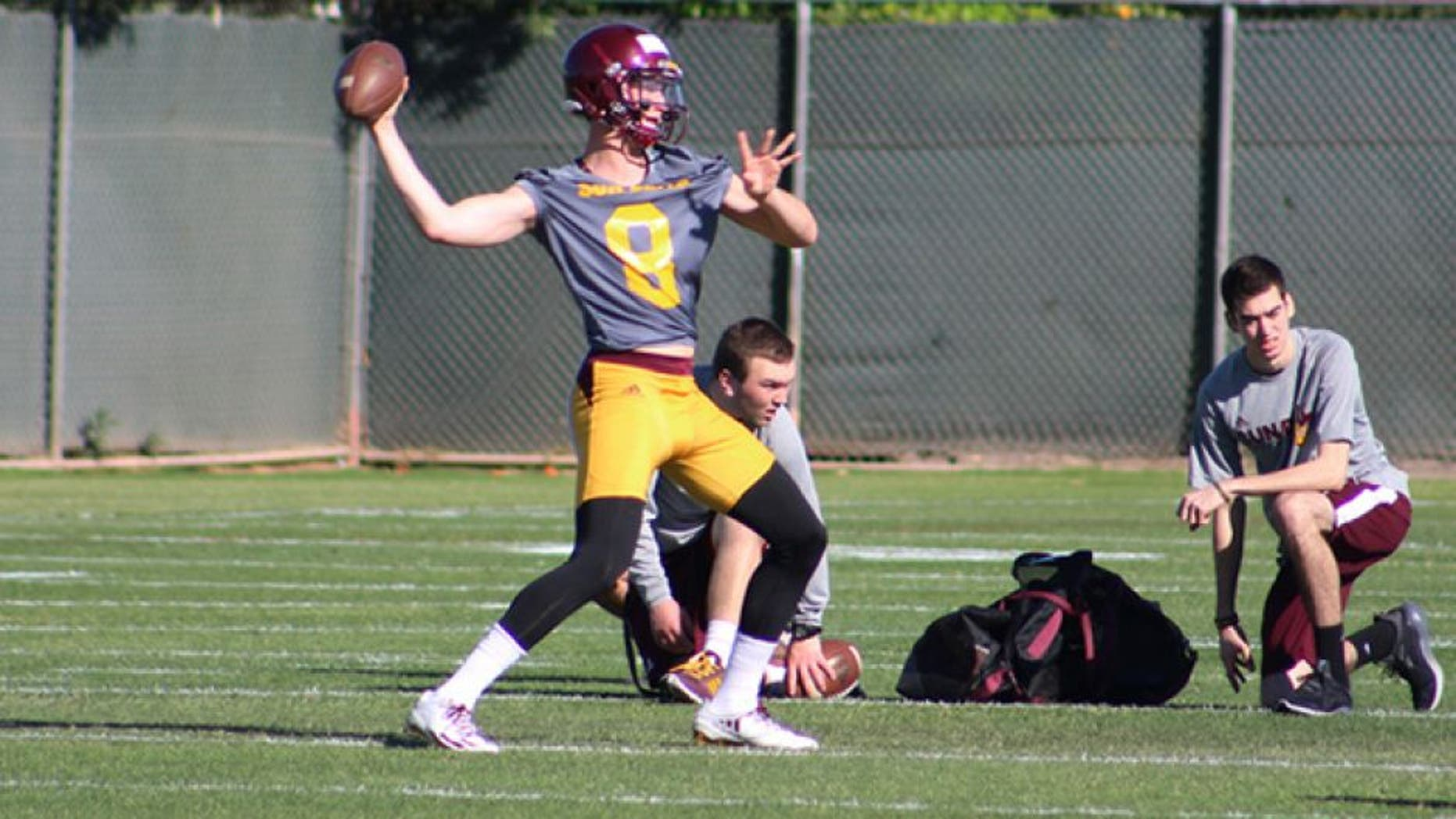 Arizona State University quarterback Blake Barnett pulls back for the throw during spring workouts on Tuesday, March 14, 2017, in Tempe, Ariz. (Photo by Tyler Drake/ Cronkite News)