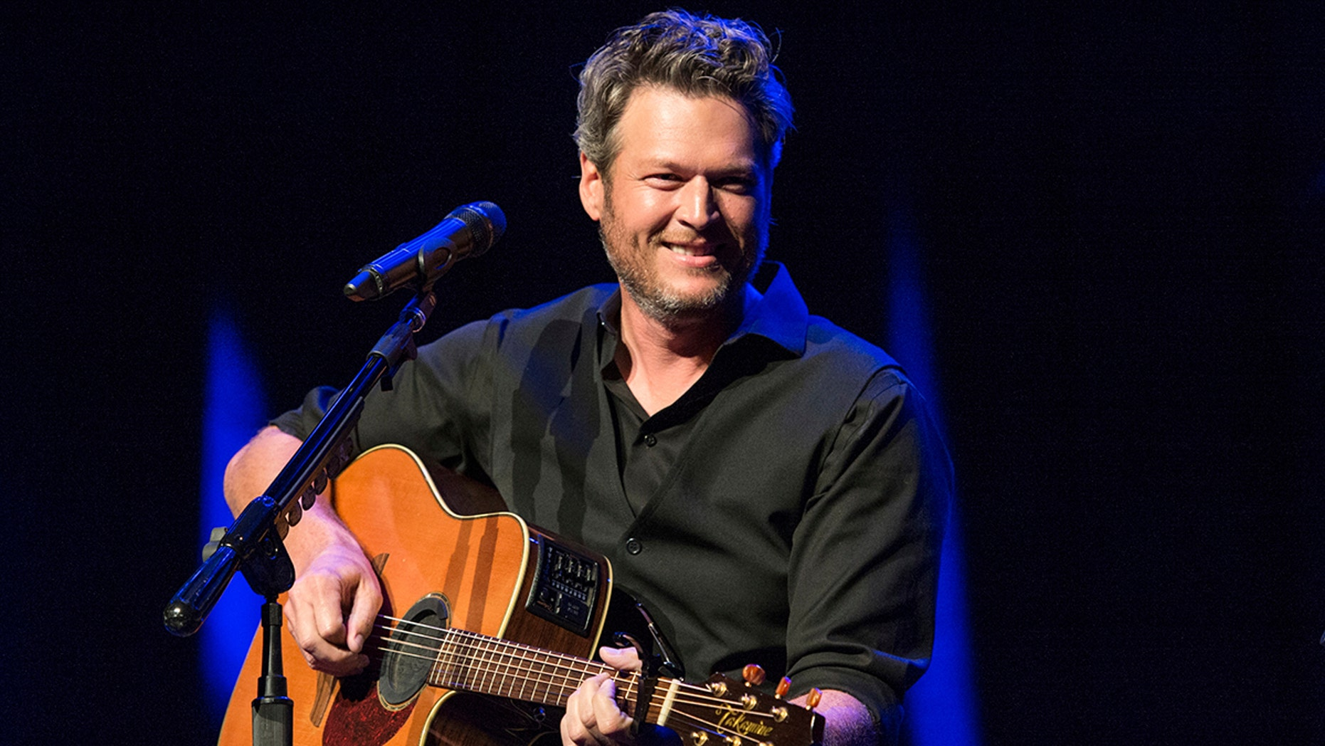 "FILE - This June 7, 2016 file photo shows Blake Shelton performing at the 12th Annual Stars for Second Harvest Benefit at Ryman Auditorium in Nashville, Tenn. Shelton was named as People magazine's 2017 ""Sexiest Man Alive.""   (Photo by Amy Harris/Invision/AP, File)"