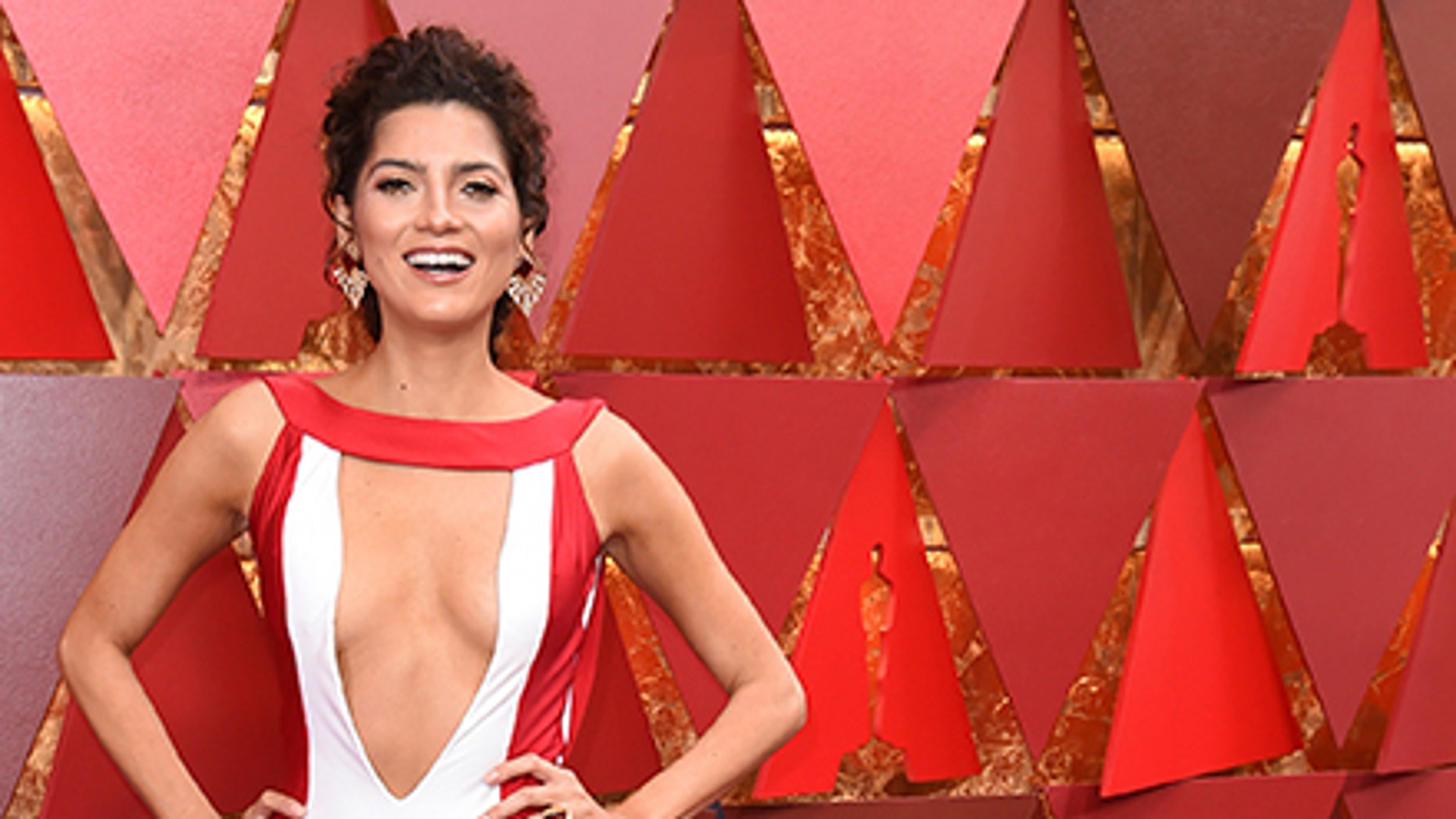 Blanca Blanco is known for making a statement with her red carpet looks and her latest ensemble did not disappoint. The actress chose a white gown with red detailing and a plunging neckline.