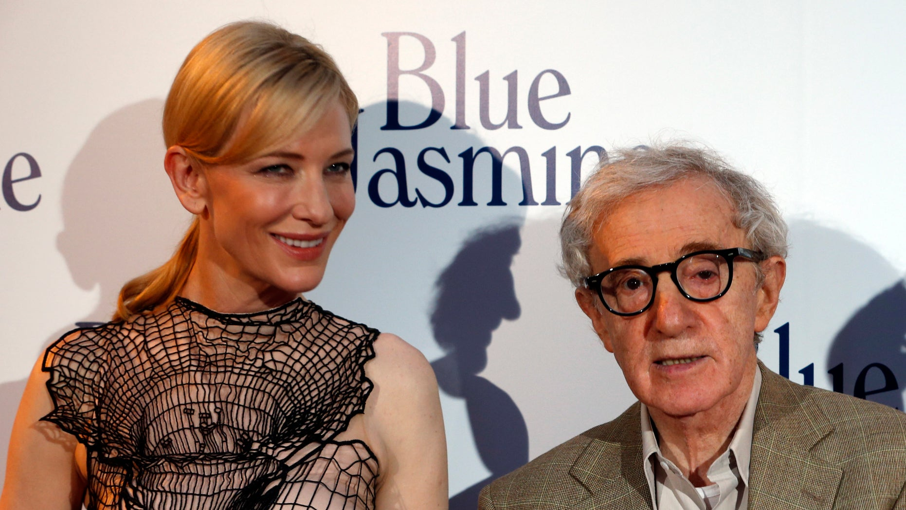 "August 27, 2013. Woody Allen (R) and Cate Blanchett pose during the premiere of the film ""Blue Jasmine"" in Paris."