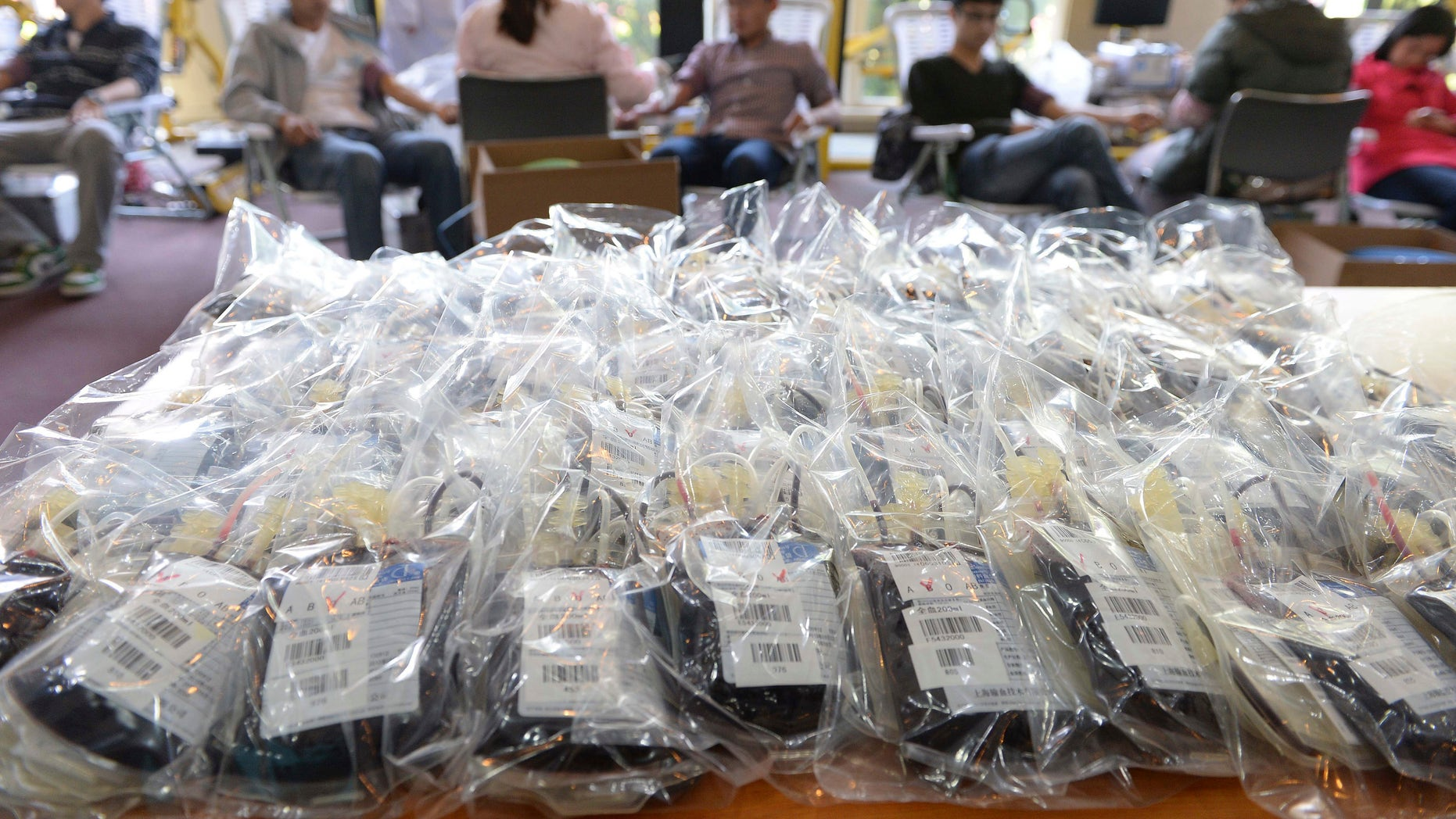 Blood packs, donated by college students, are seen on a table at a hospital in Shanghai, April 23, 2014. REUTERS/Stringer