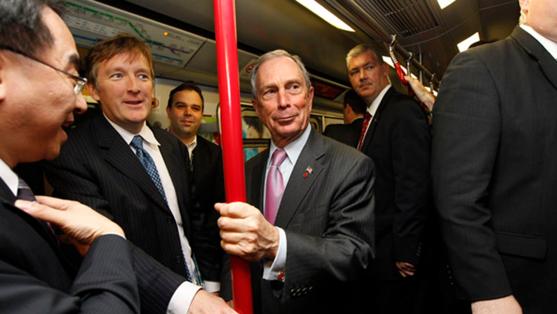 FILE: In this Nov. 6 picture, New York City Mayor Michael Bloomberg rides on the Mass Transit Railway, an underground train in Hong Kong, during a convention of large city leaders who met to discuss climate change.