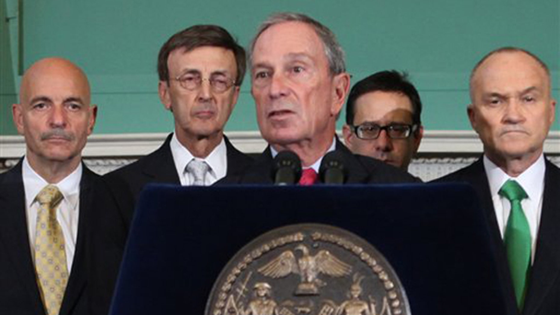 New York City Mayor Michael Bloomberg, center, addresses the media Aug. 25 in New York.