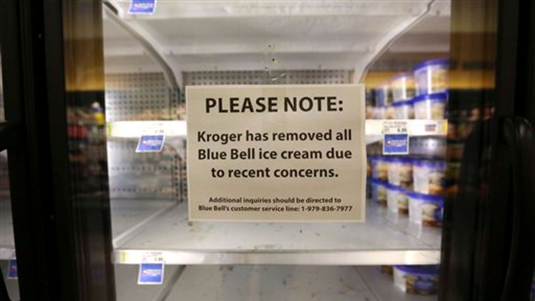 A sign explains why shelves sit empty of Blue Bell ice cream at a grocery store in Dallas, Tuesday, April 21, 2015.(AP Photo/LM Otero)