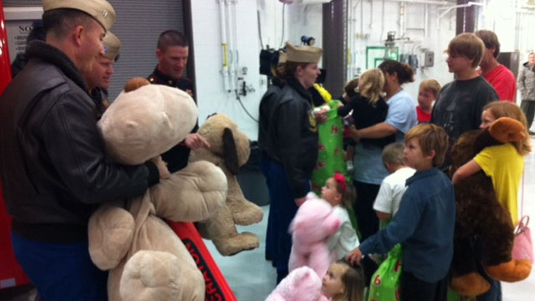 Nov. 22, 2011: Blue Angels bring gifts to children displaced by tornadoes.