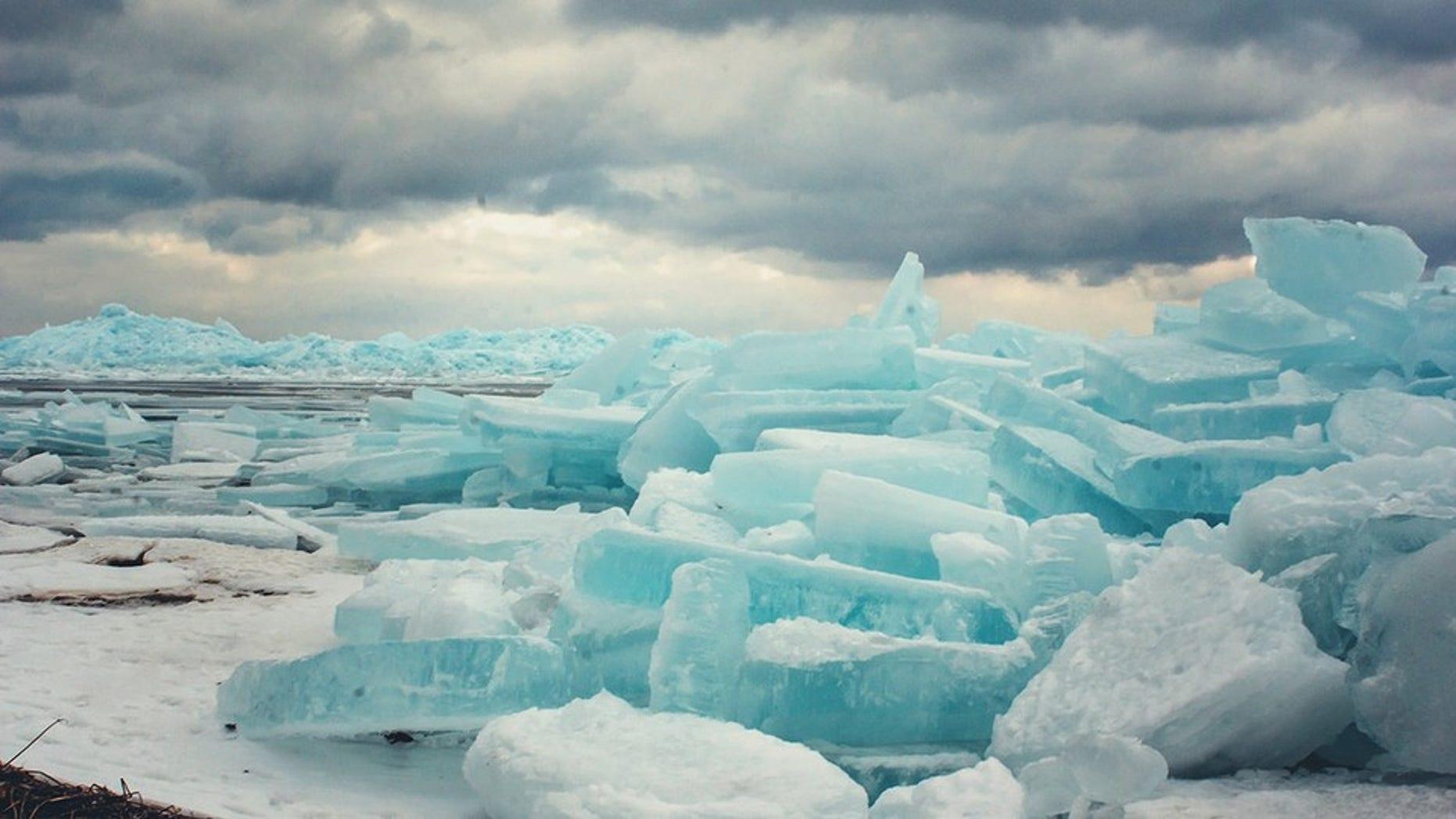 Photographer Tori Burley captures a stunning photo of blue ice forming under the Mackinac Bridge in Michigan.