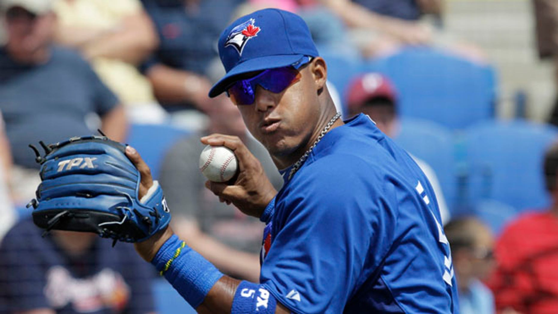 March 24, 2012: This file photo, shows Toronto Blue Jays shortstop Yunel Escobar warming up before a spring training baseball game against the Atlanta Braves, in Dunedin, Fla.