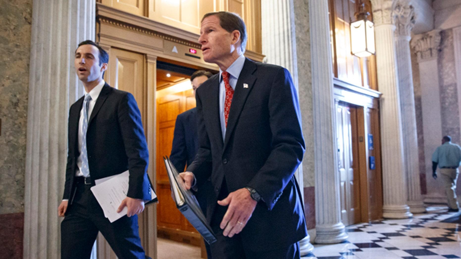 Dec. 18, 2013: Sen. Richard Blumenthal, D-Conn., right, walks to the Senate chamber on Capitol Hill.