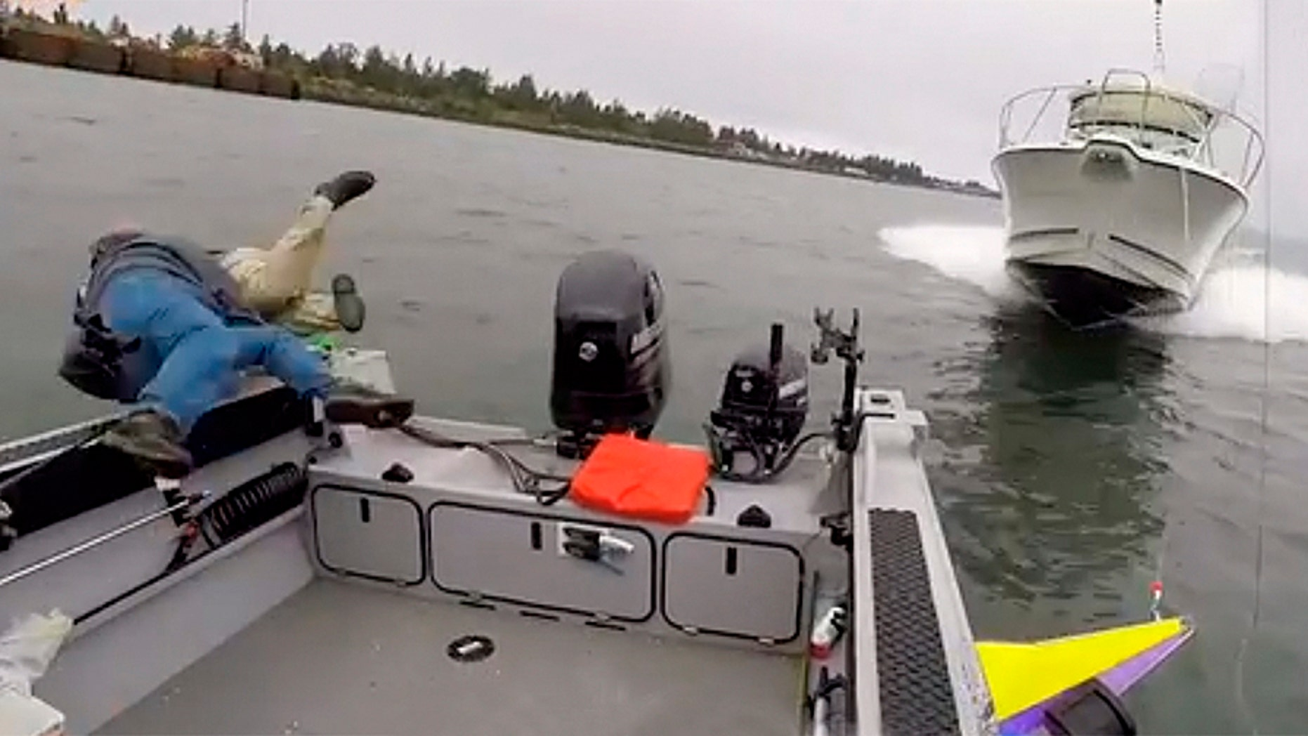 A fisherman who was caught on camera jumping ship into the Columbia River to avoid being struck by an oncoming motorboat is suing the other driver.