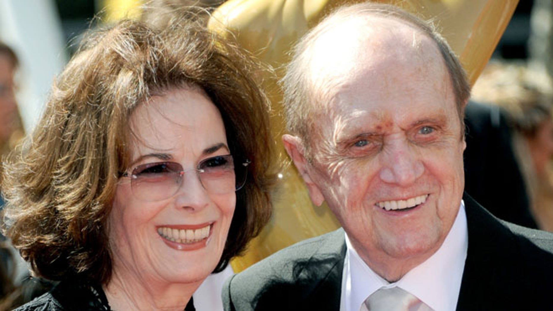 Bob Newhart, right, and wife Ginny Newhart arrive at the Primetime Creative Arts Emmy Awards at the Nokia Theatre L.A. Live on Sunday, Sept. 15, 2013, in Los Angeles. (Photo by Richard Shotwell/Invision/AP)