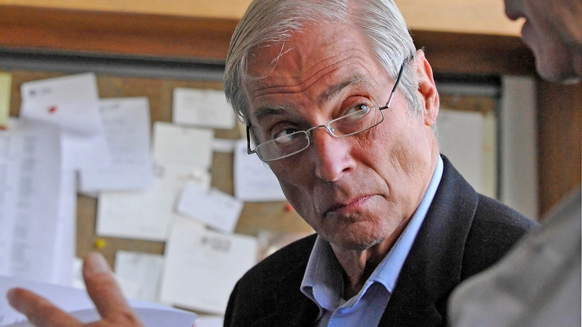 March 24, 2010. Bob Simon, speaks with a news producer at the CBS Broadcast Center in New York.