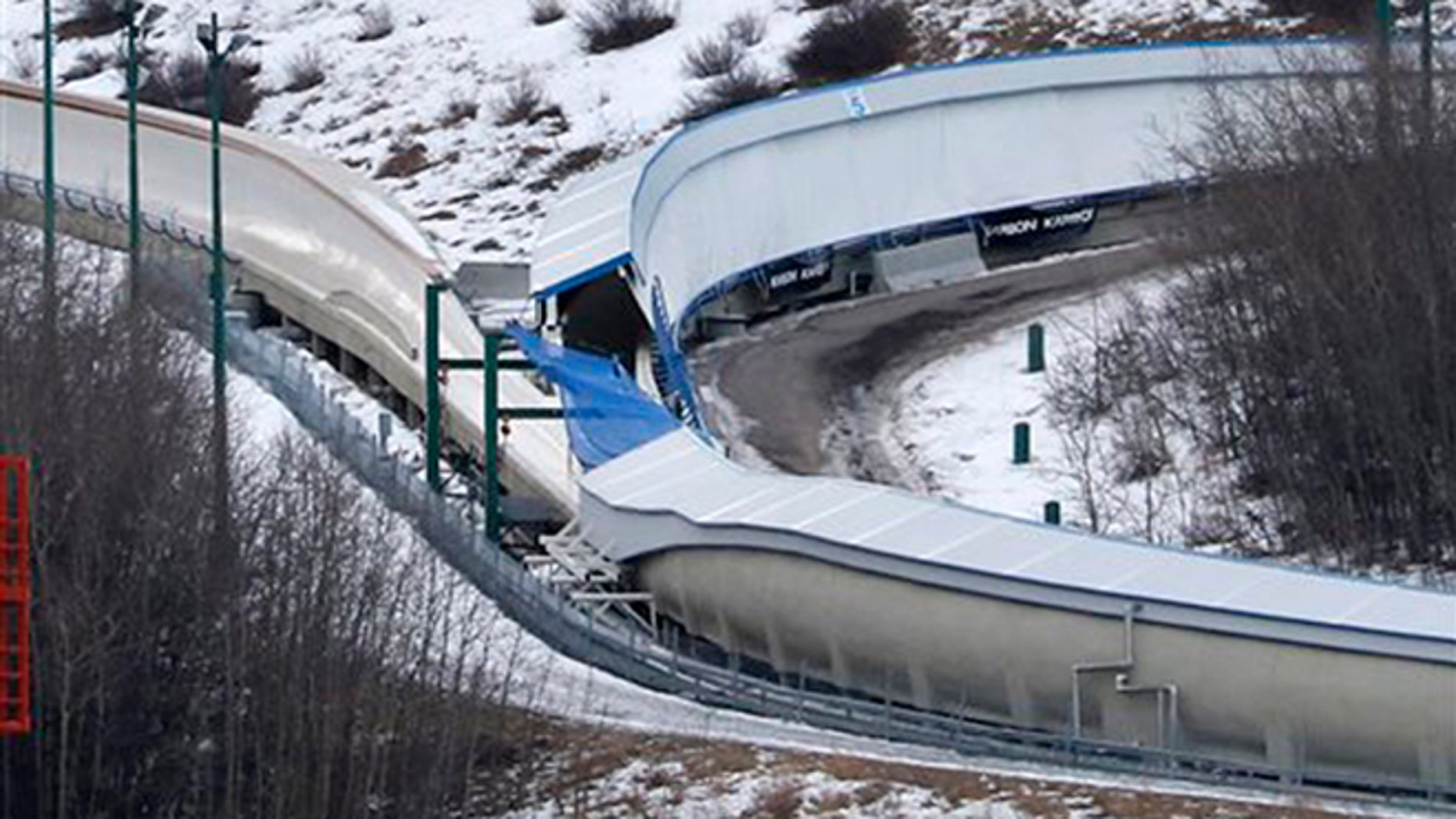 A tarp covers the intersection of the bobsled and luge tracks at Canada Olympic Park in Calgary, Canada, on Saturday, Feb. 6, 2016.  Calgary police say emergency crews were called to the WinSport facility in northwest Calgary early in the morning after a report of several injured people on a closed track.  Eight teenagers, all males, entered the property after hours and used toboggans to go down the bobsled track.  (Larry MacDougal/The Canadian Press via AP) MANDATORY CREDIT