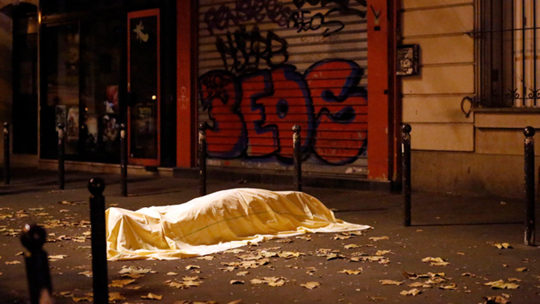 Nov. 13, 2015. A victim of an attack in Paris lays dead outside the Bataclan theater, Paris.