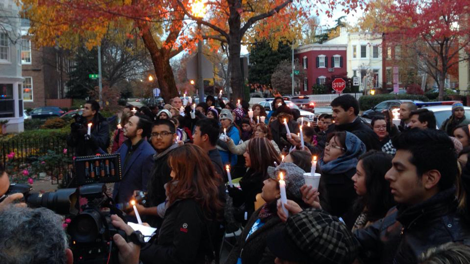 Immigrants hold a protest vigil for immigration reform outside the home of House Speaker John Boehner.