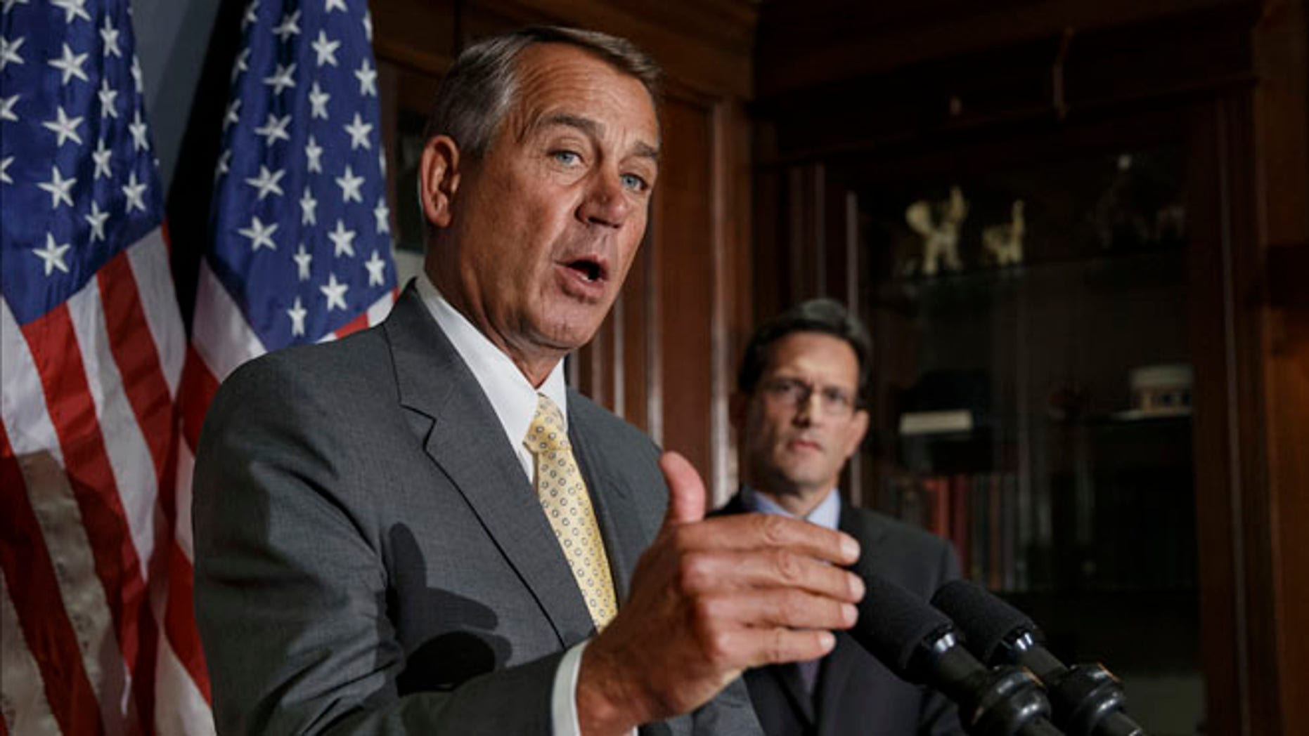 Jan. 28, 2014: House Speaker John Boehner, left, with House Majority Leader Eric Cantor, talks with reporters at Republican National Committee headquarters in Washington.