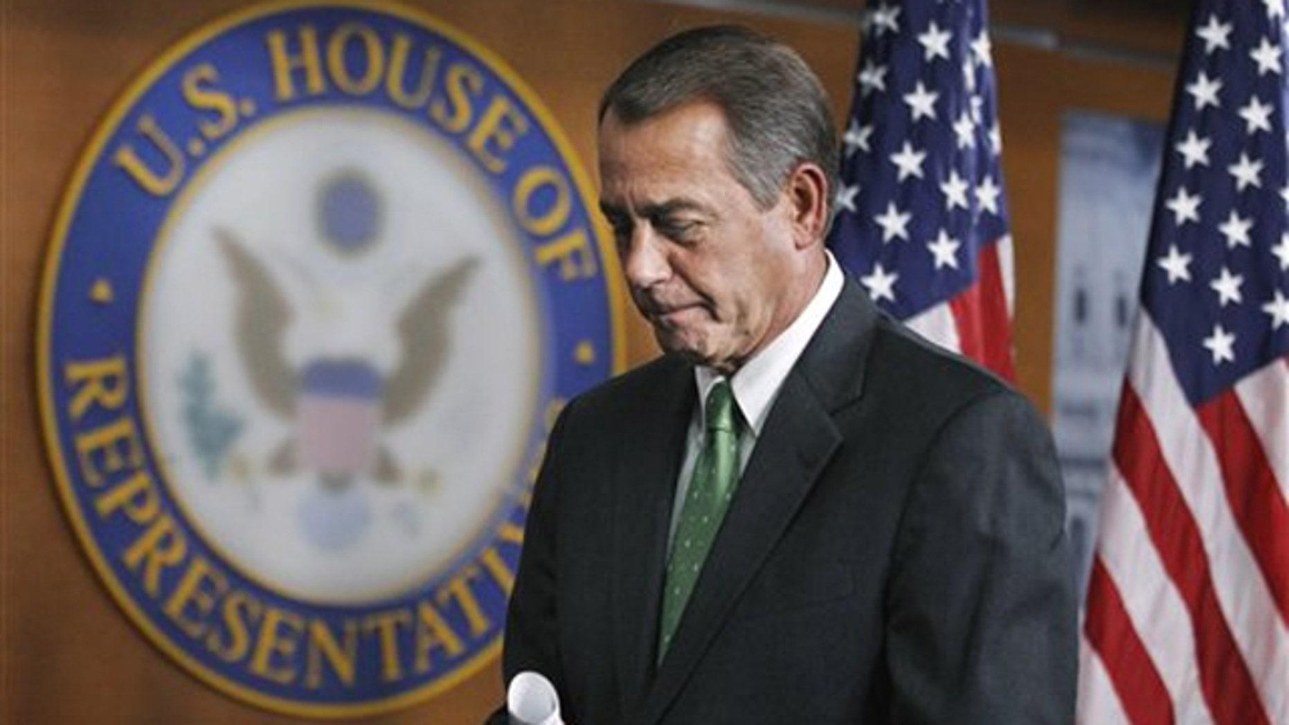 House Speaker John Boehner leaves a news conference on Capitol Hill in Washington Feb. 10.