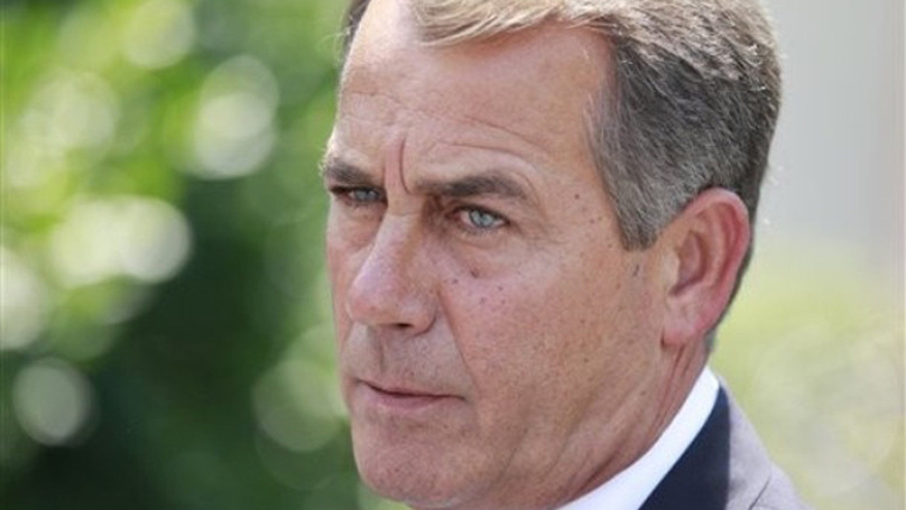 In this June 10 photo, House Minority Leader John Boehner of Ohio speaks to reporters outside the White House. (AP Photo)